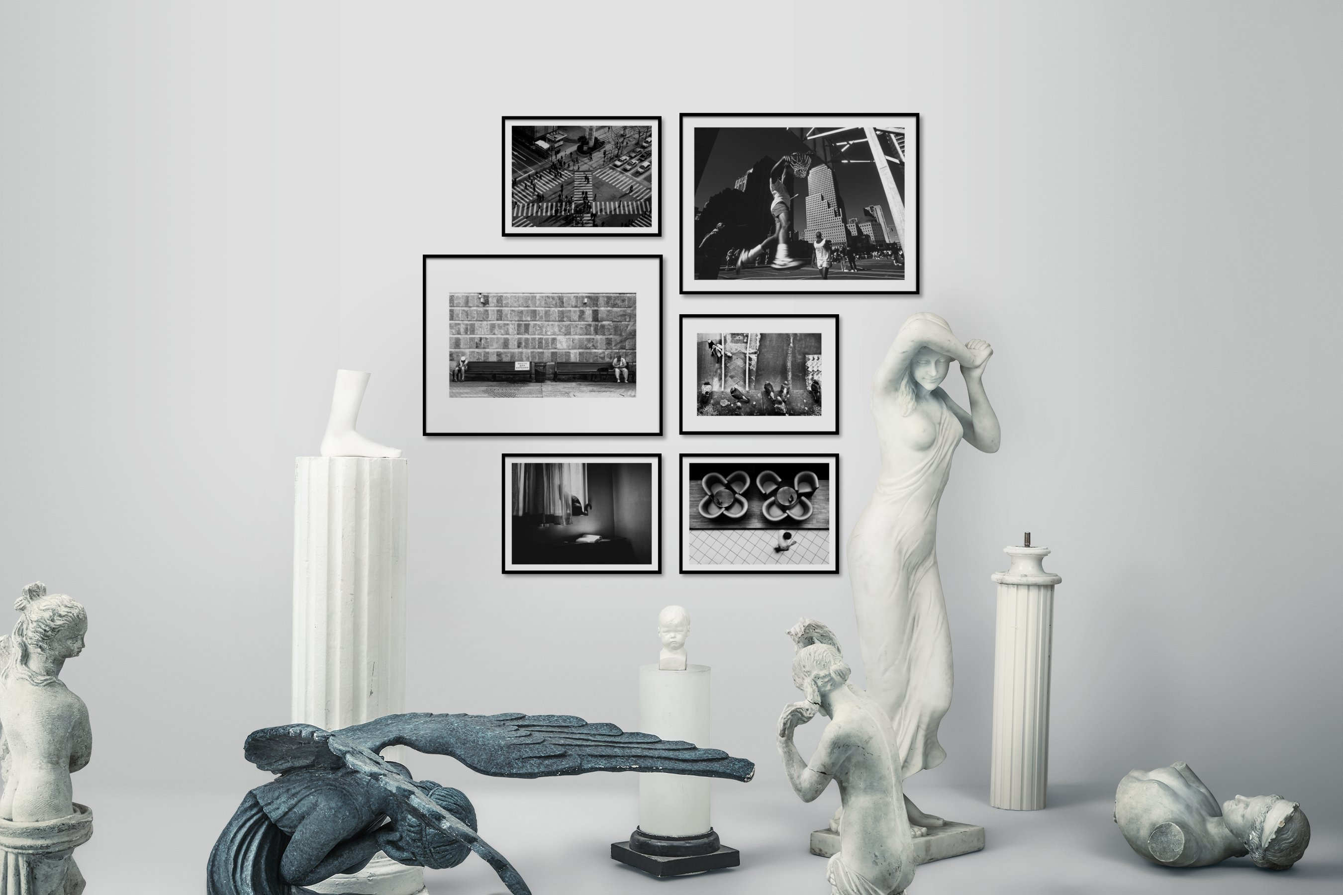Gallery wall idea with six framed pictures arranged on a wall depicting Black & White, City Life, Americana, Vintage, Animals, and For the Moderate