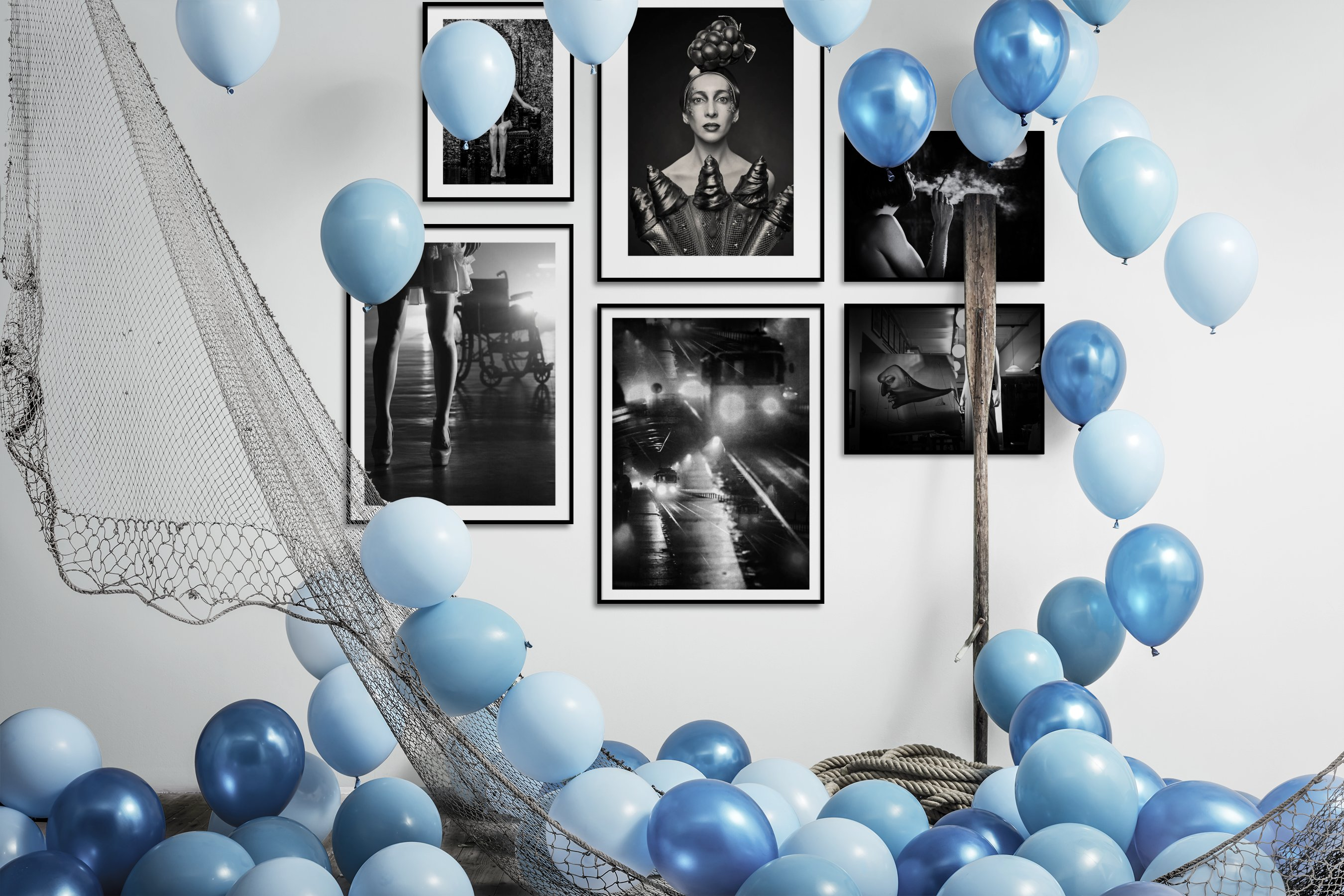 Gallery wall idea with six framed pictures arranged on a wall depicting Fashion & Beauty, Artsy, Black & White, and Vintage