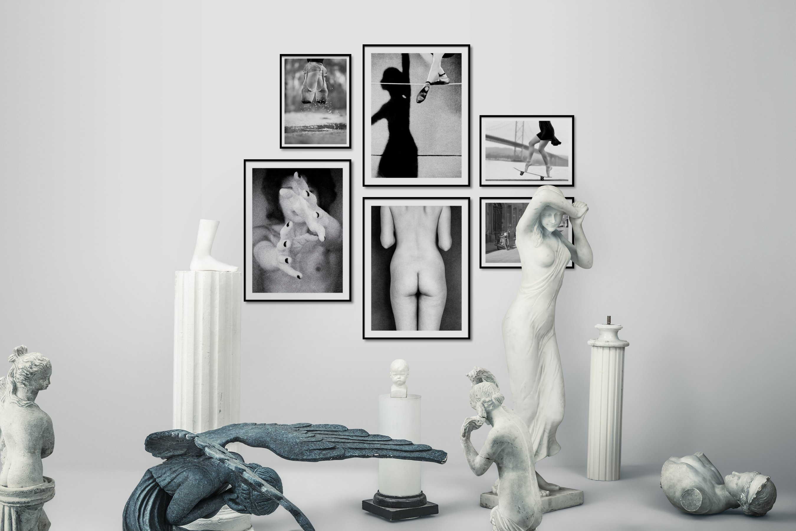 Gallery wall idea with six framed pictures arranged on a wall depicting Fashion & Beauty, Black & White, For the Moderate, City Life, and Vintage