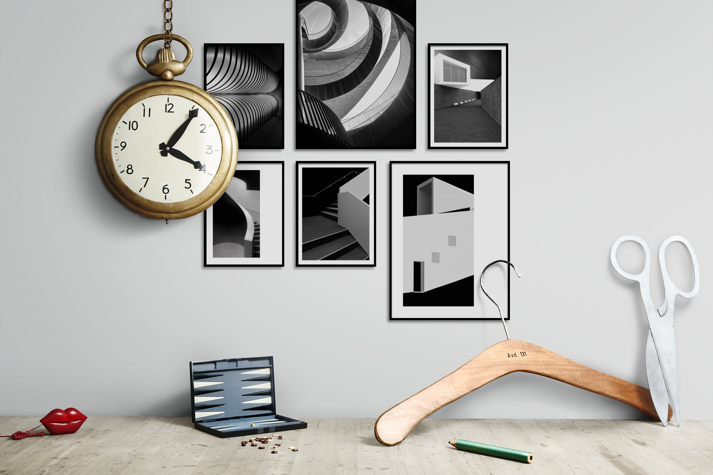 Gallery wall idea with six framed pictures arranged on a wall depicting Black & White, For the Moderate, and For the Minimalist