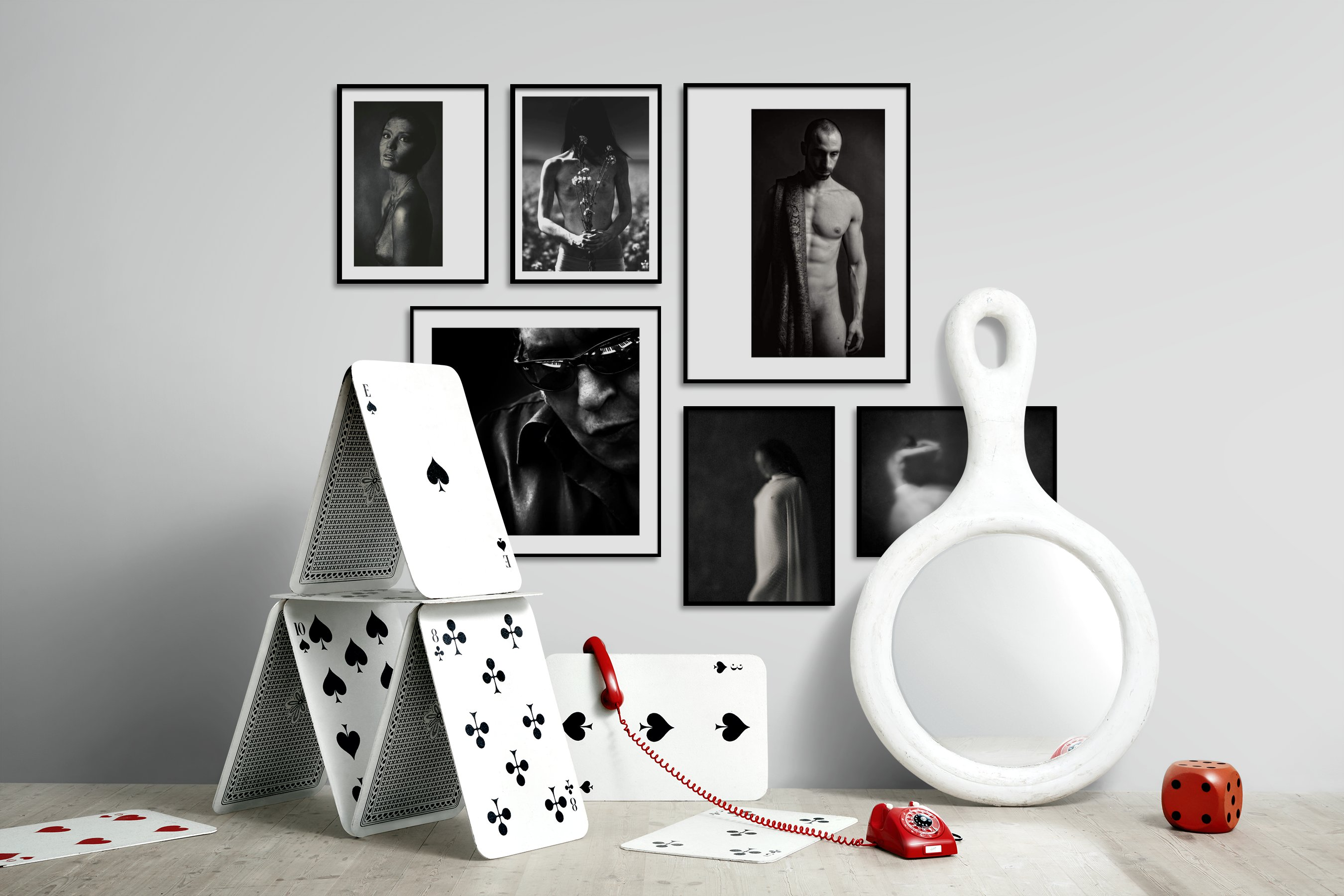 Gallery wall idea with six framed pictures arranged on a wall depicting Fashion & Beauty, Black & White, Bold, Artsy, and For the Moderate