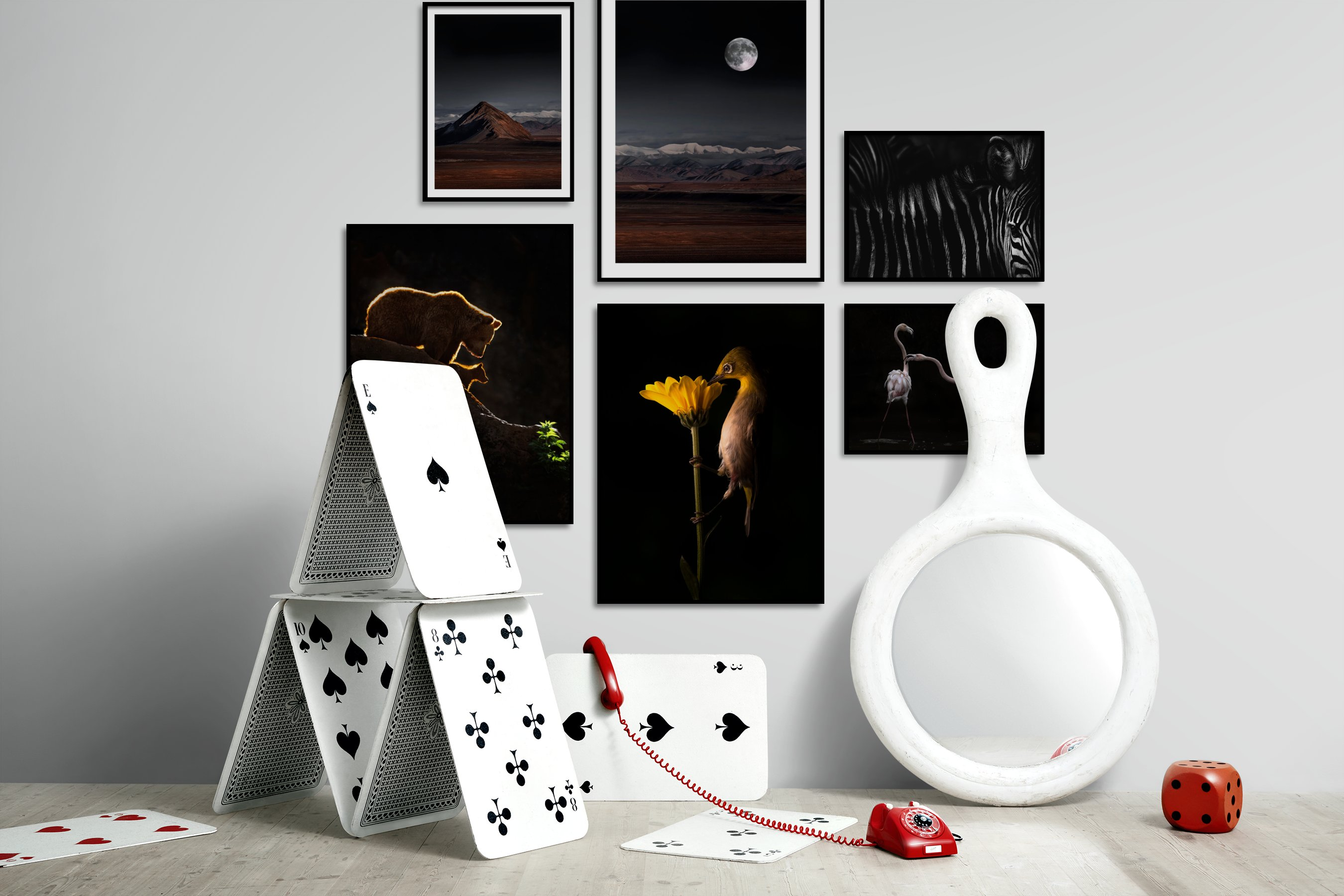 Gallery wall idea with six framed pictures arranged on a wall depicting Nature, Dark Tones, For the Minimalist, Animals, Black & White, and For the Moderate