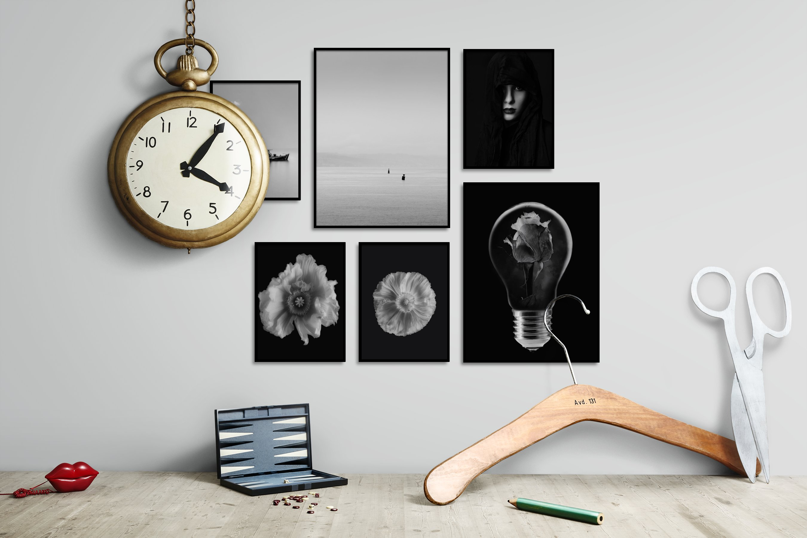 Gallery wall idea with six framed pictures arranged on a wall depicting Black & White, For the Minimalist, Beach & Water, Mindfulness, Dark Tones, and Flowers & Plants