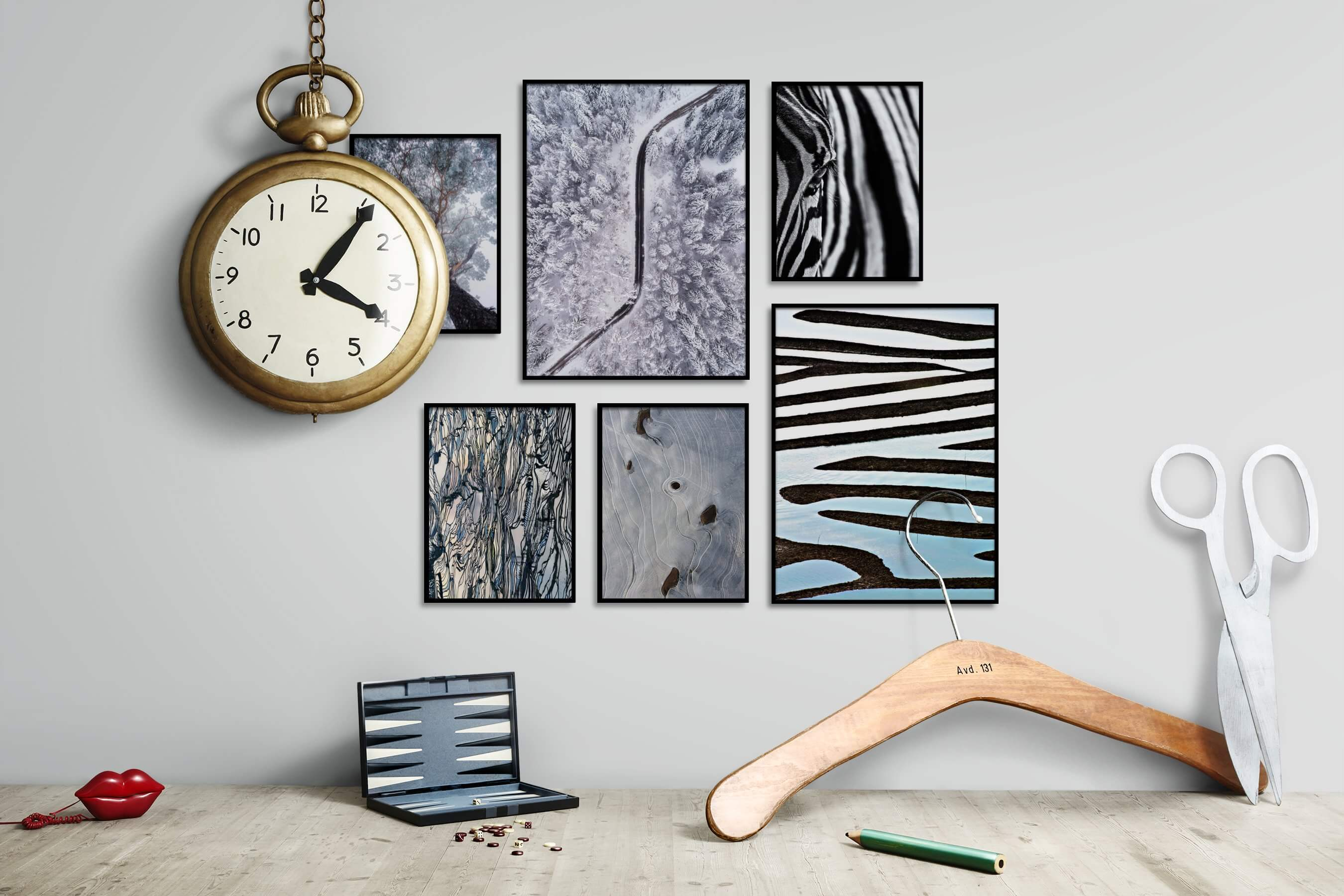 Gallery wall idea with six framed pictures arranged on a wall depicting For the Moderate, Nature, Mindfulness, For the Maximalist, Black & White, and Animals