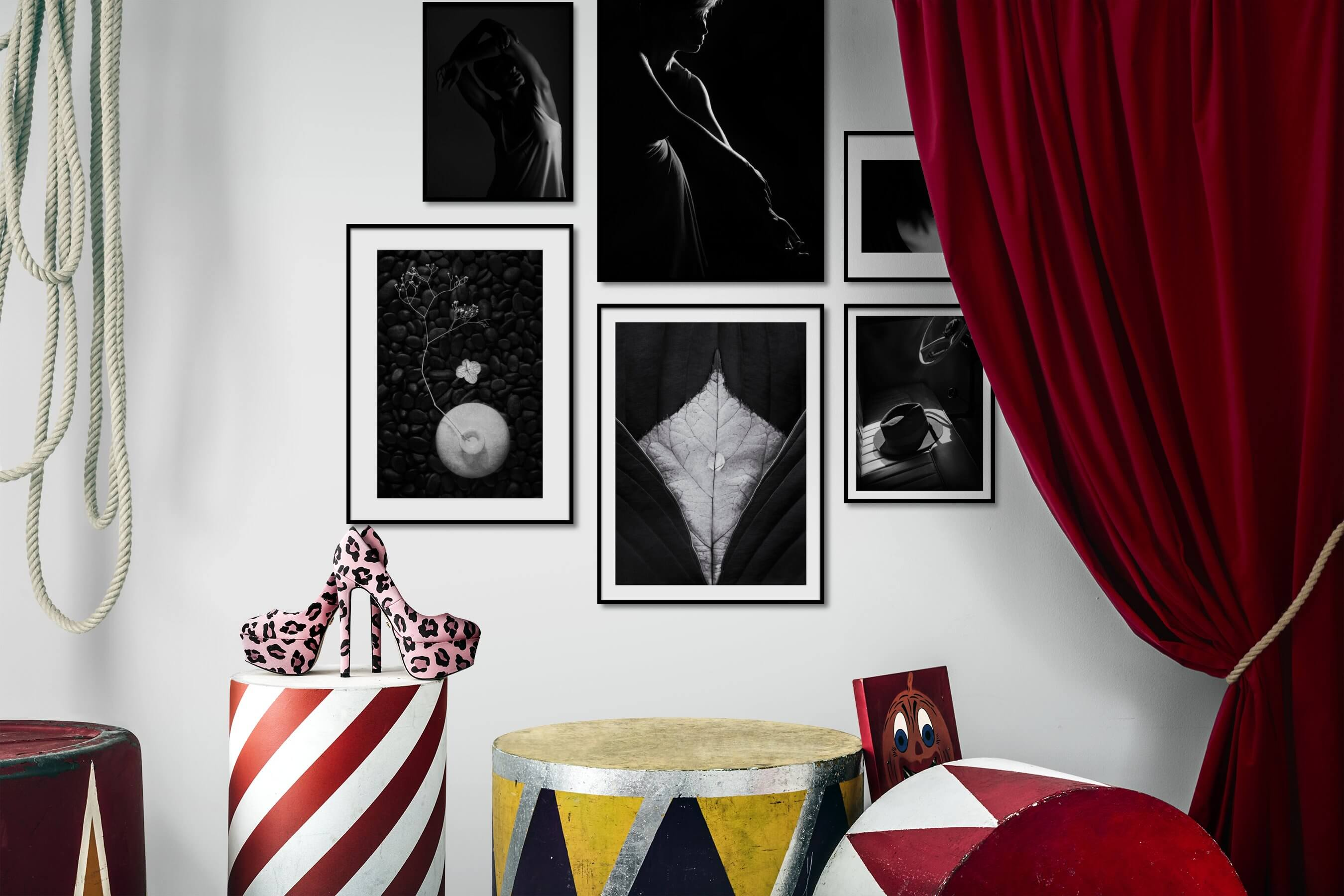 Gallery wall idea with six framed pictures arranged on a wall depicting Fashion & Beauty, Black & White, Dark Tones, For the Minimalist, Flowers & Plants, Mindfulness, For the Moderate, and Vintage