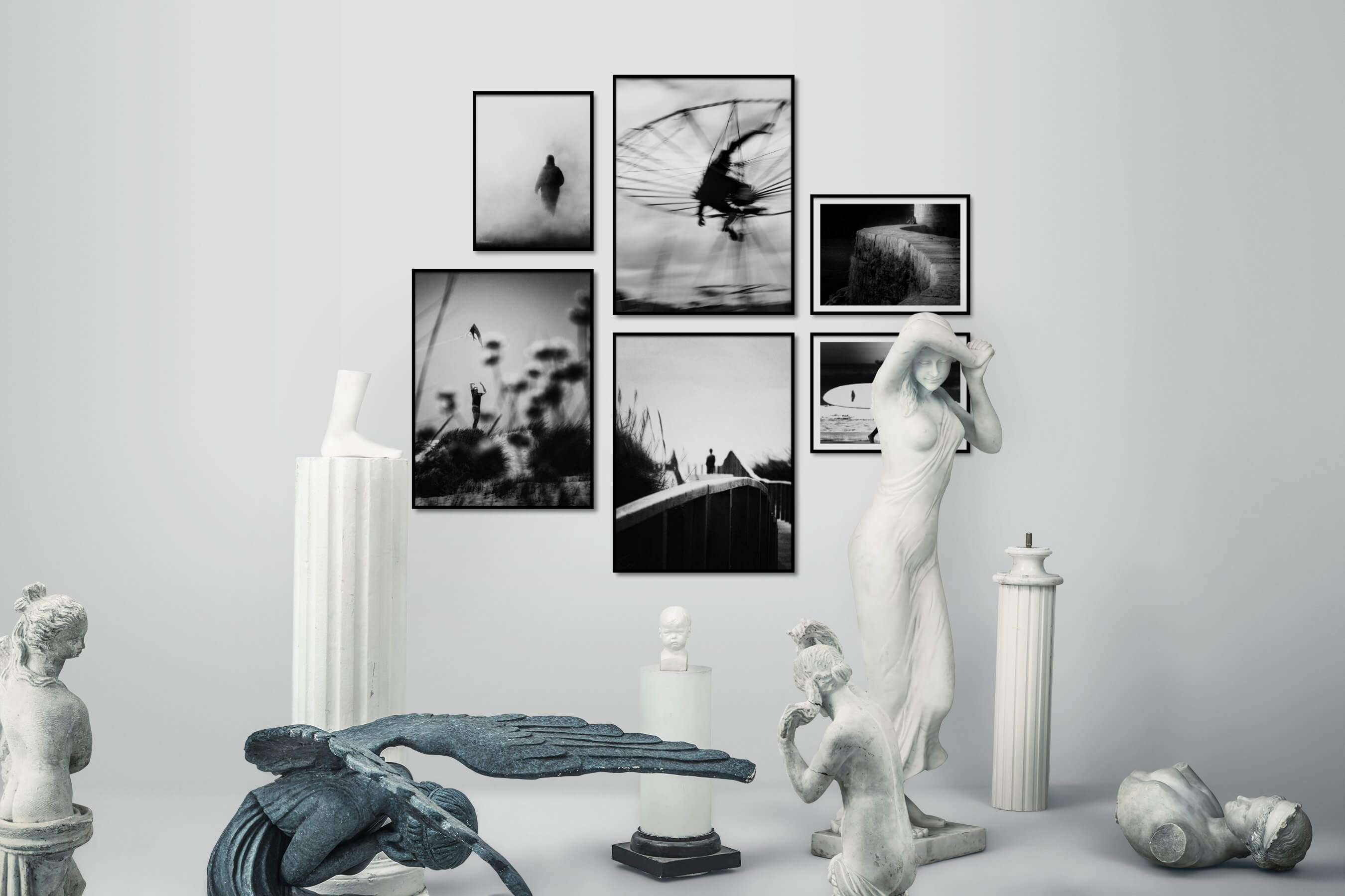 Gallery wall idea with six framed pictures arranged on a wall depicting Black & White, For the Minimalist, For the Moderate, and Beach & Water