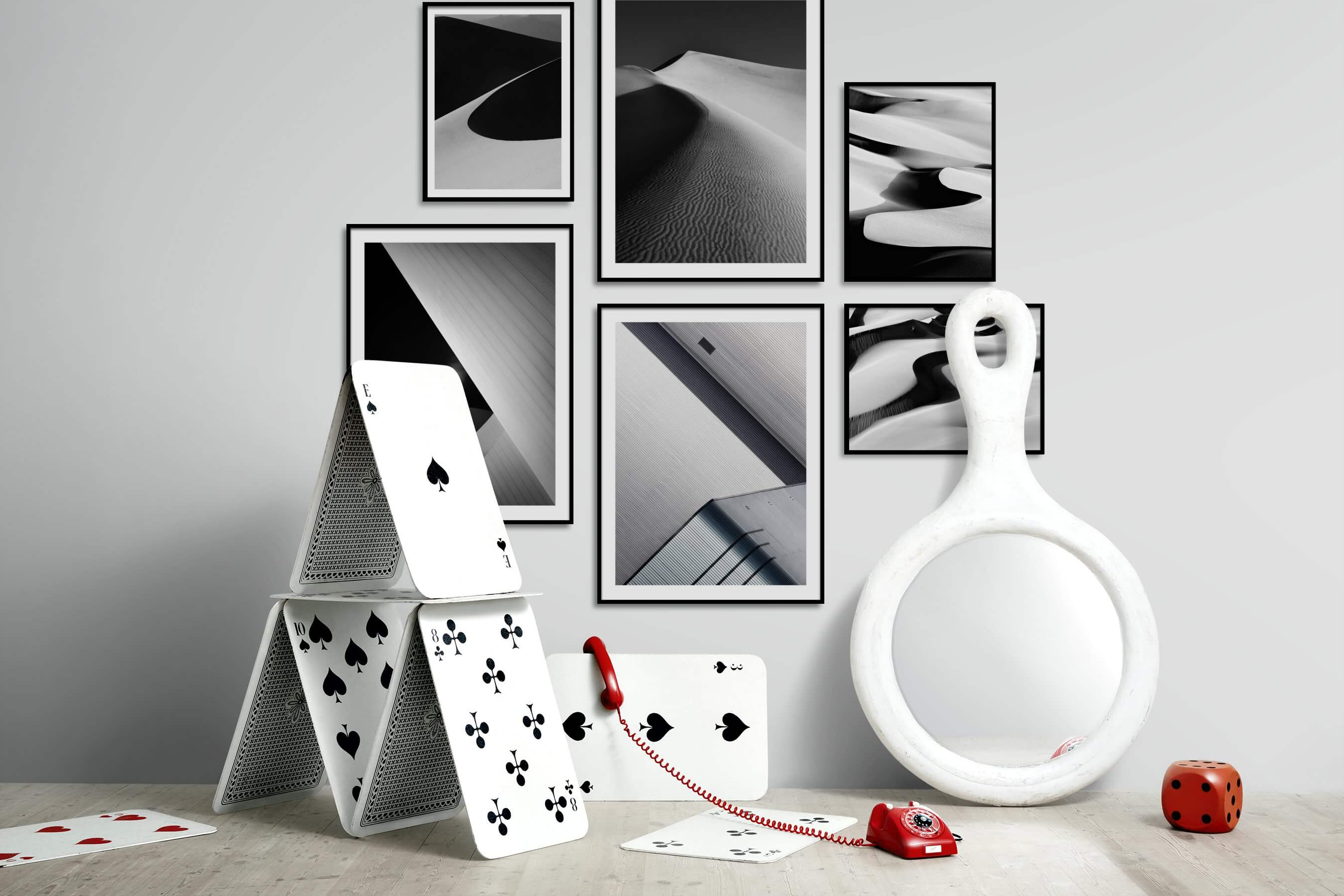 Gallery wall idea with six framed pictures arranged on a wall depicting Black & White, For the Minimalist, Nature, and For the Moderate