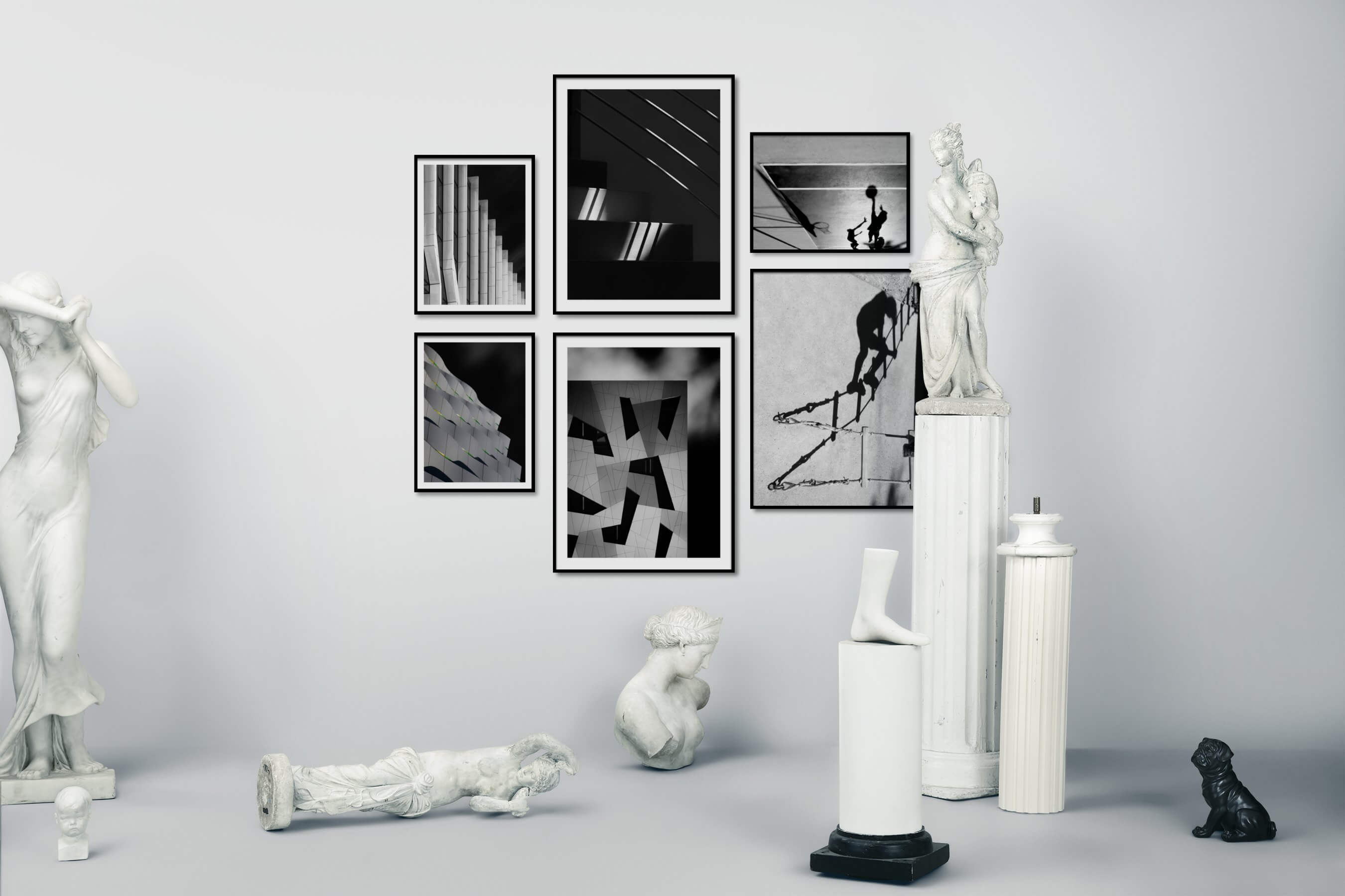 Gallery wall idea with six framed pictures arranged on a wall depicting Black & White and For the Moderate