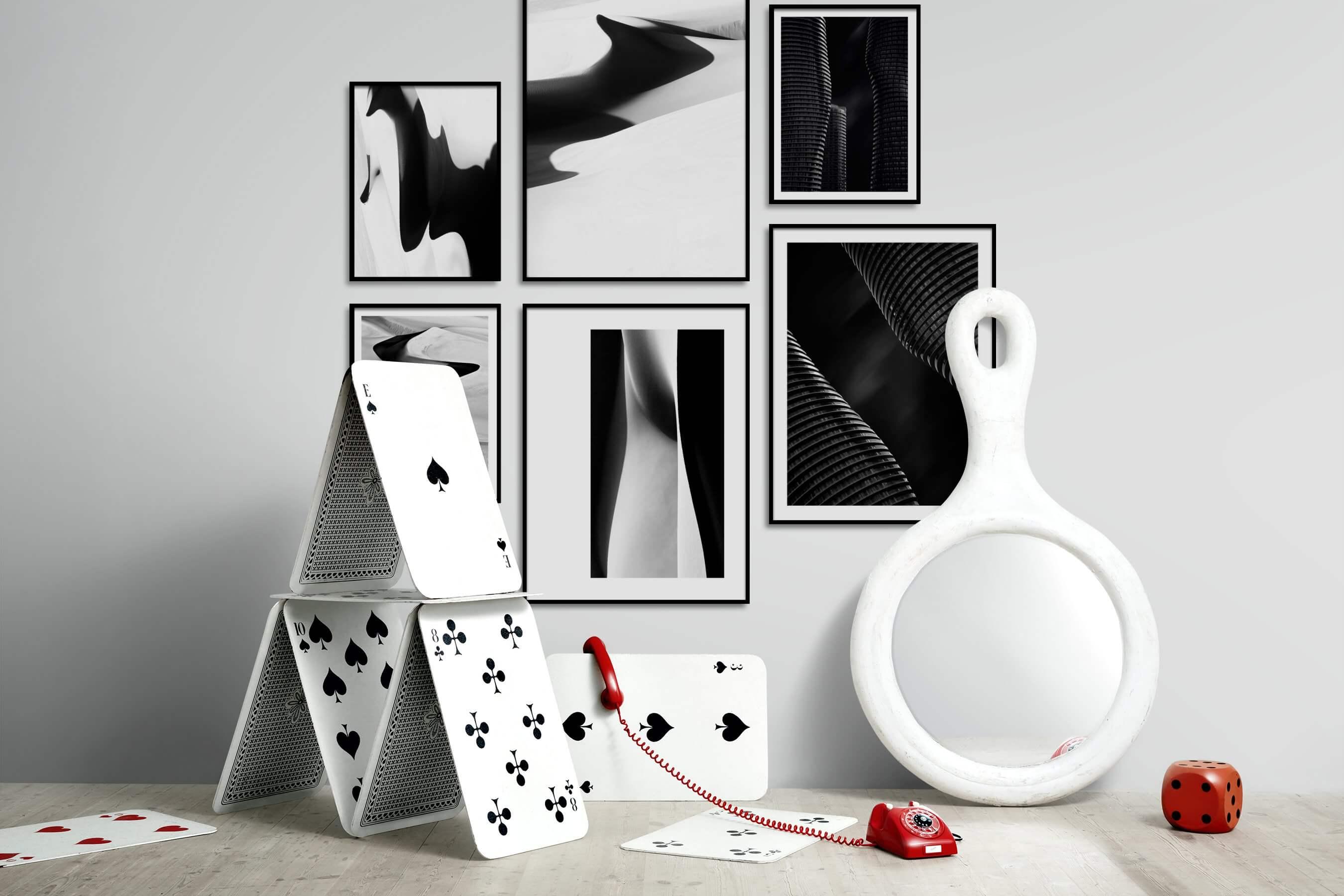 Gallery wall idea with six framed pictures arranged on a wall depicting Black & White, For the Minimalist, Nature, For the Moderate, and City Life