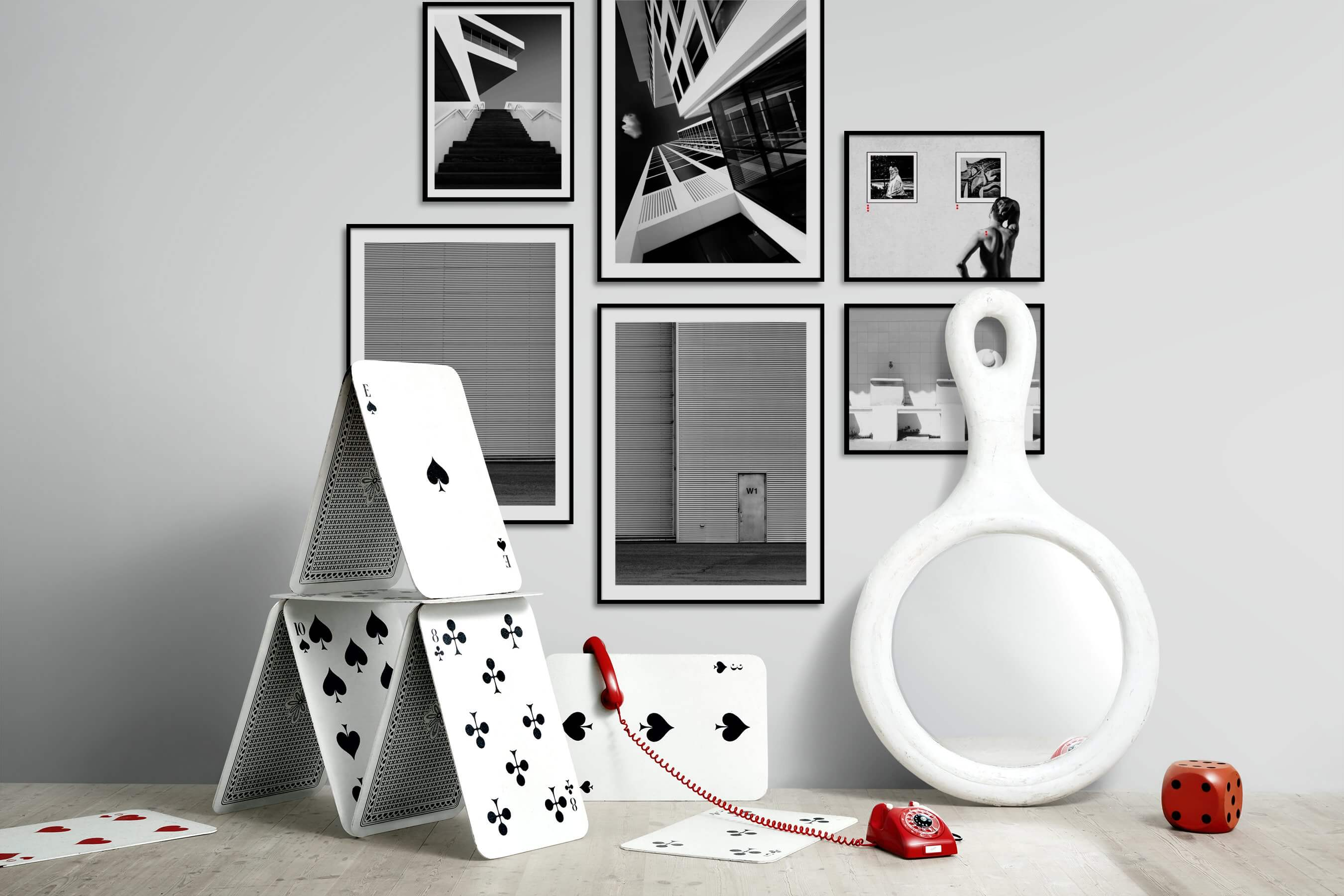 Gallery wall idea with six framed pictures arranged on a wall depicting Black & White, For the Moderate, City Life, For the Minimalist, and Artsy