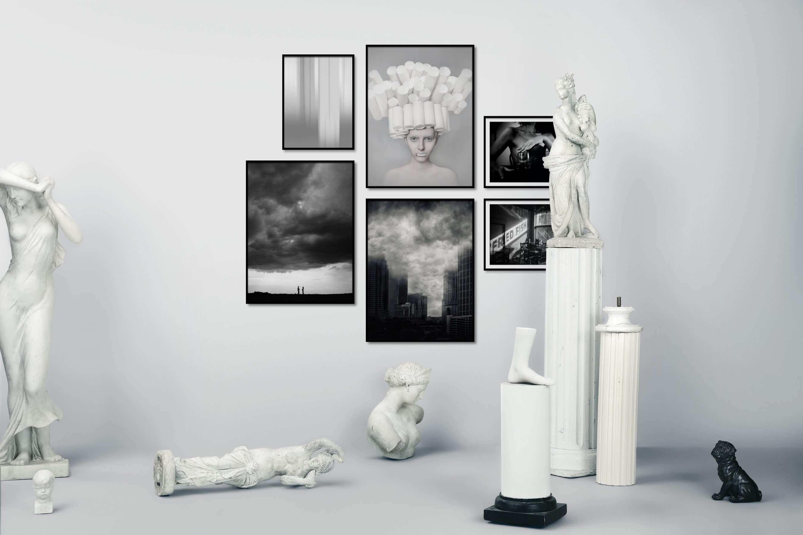 Gallery wall idea with six framed pictures arranged on a wall depicting Black & White, For the Moderate, Artsy, Country Life, City Life, Americana, Fashion & Beauty, and Bold