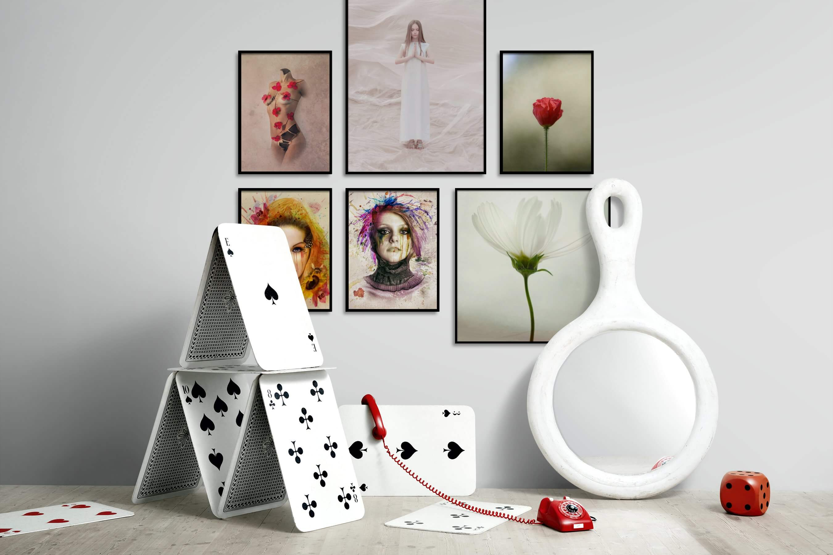 Gallery wall idea with six framed pictures arranged on a wall depicting Artsy, Fashion & Beauty, For the Minimalist, Flowers & Plants, and Vintage