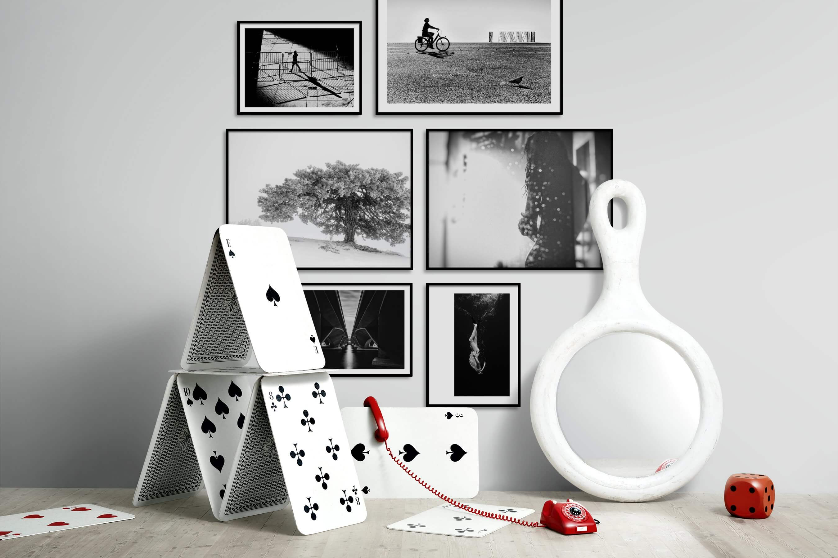 Gallery wall idea with six framed pictures arranged on a wall depicting Black & White, City Life, For the Moderate, Bright Tones, Nature, Artsy, and Beach & Water