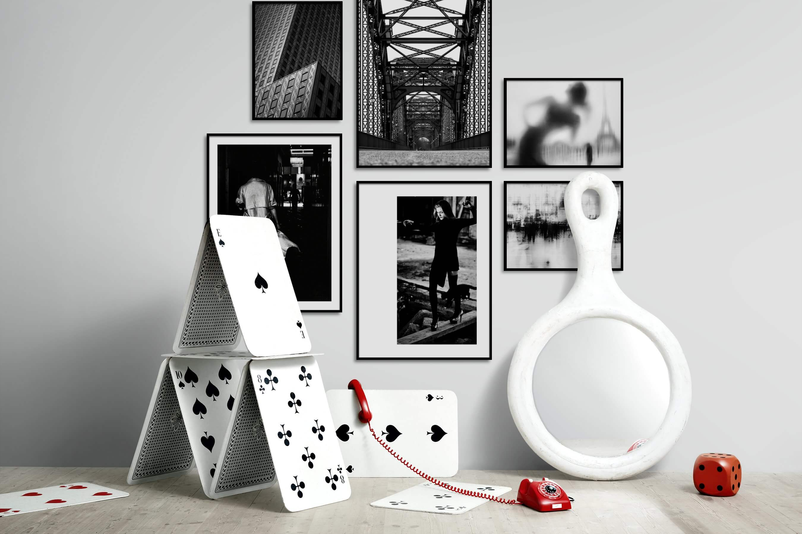 Gallery wall idea with six framed pictures arranged on a wall depicting Black & White, For the Moderate, City Life, Artsy, and Fashion & Beauty