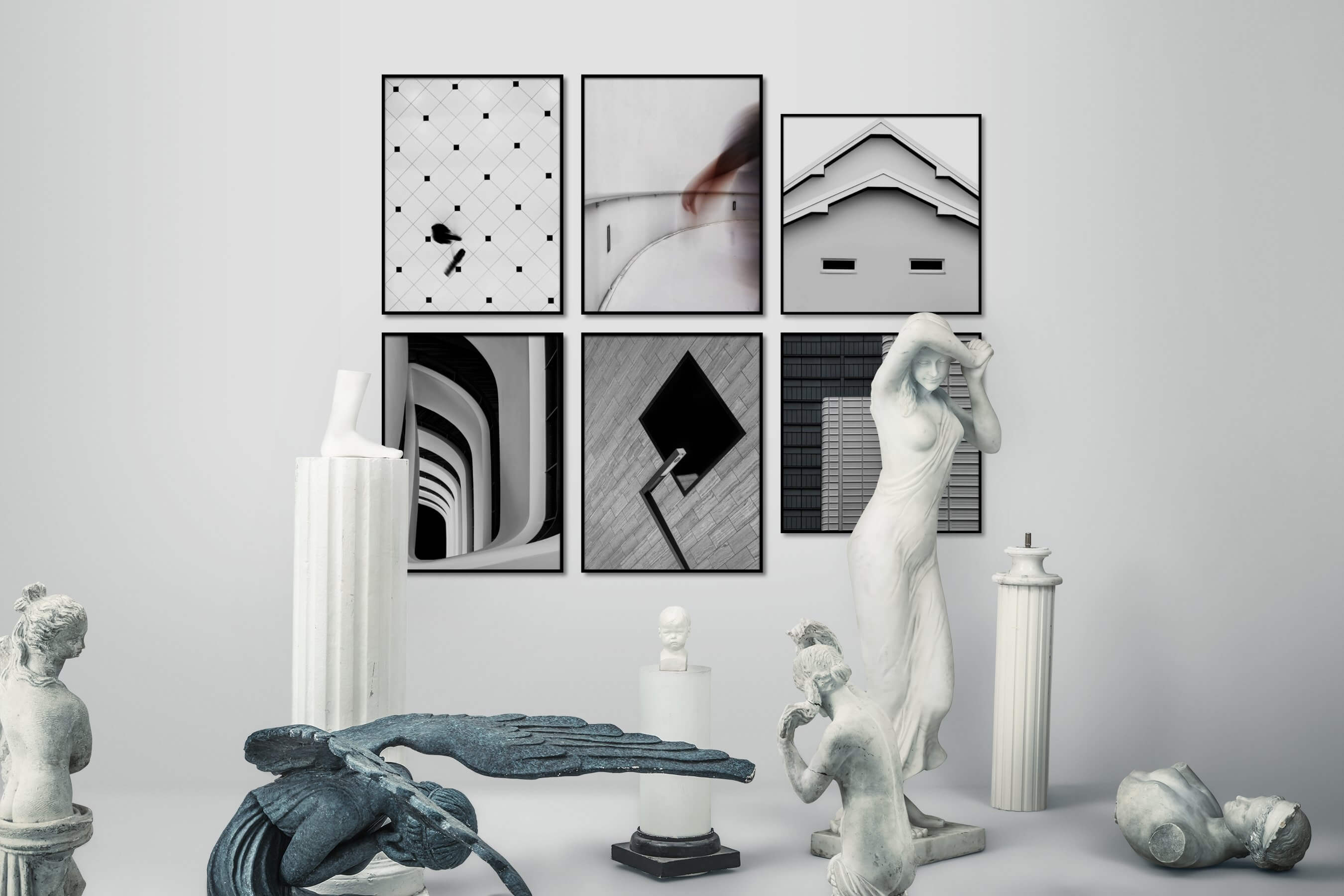 Gallery wall idea with six framed pictures arranged on a wall depicting Black & White, For the Minimalist, City Life, and For the Moderate
