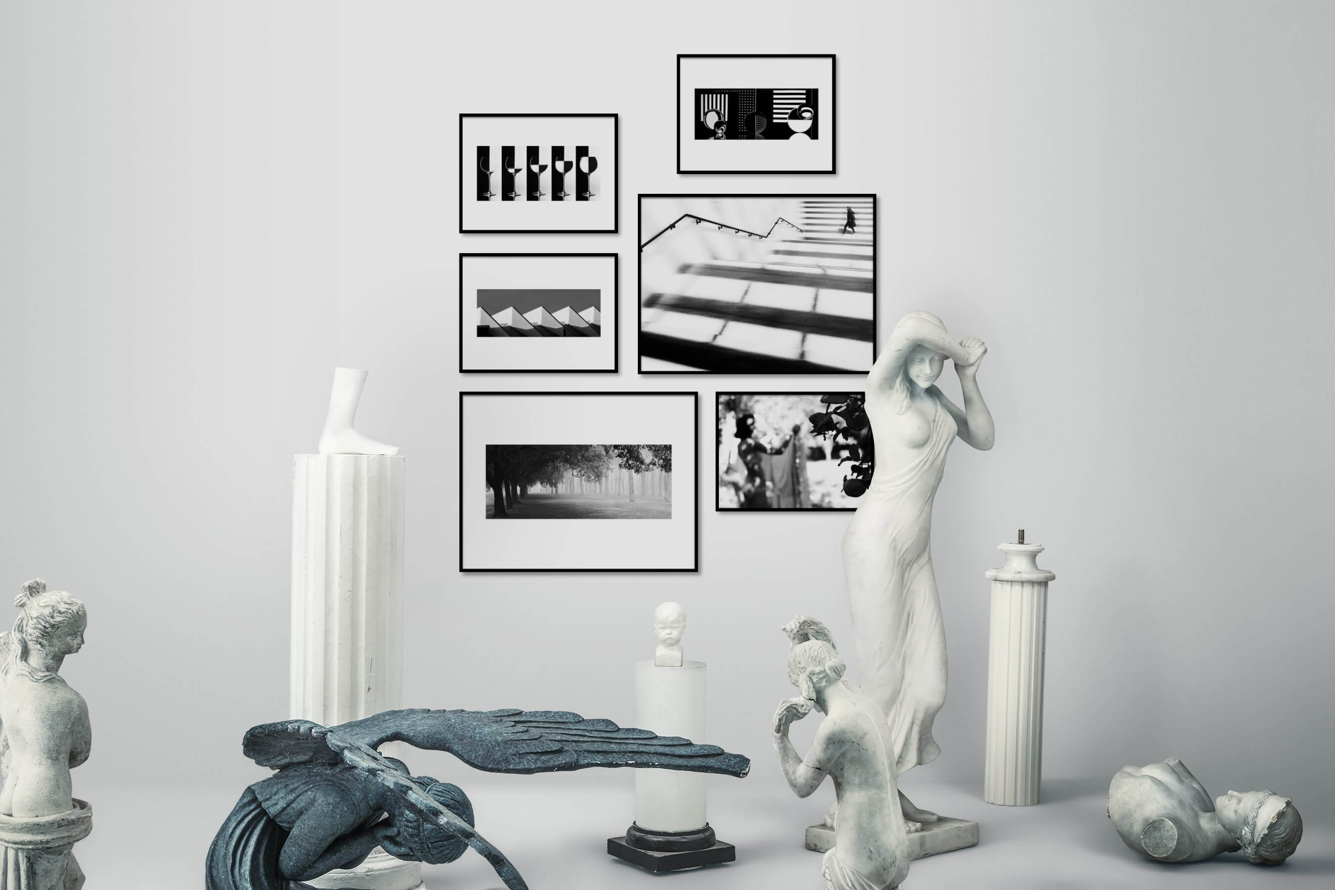 Gallery wall idea with six framed pictures arranged on a wall depicting Black & White, For the Moderate, For the Minimalist, City Life, Nature, Mindfulness, Flowers & Plants, and Country Life