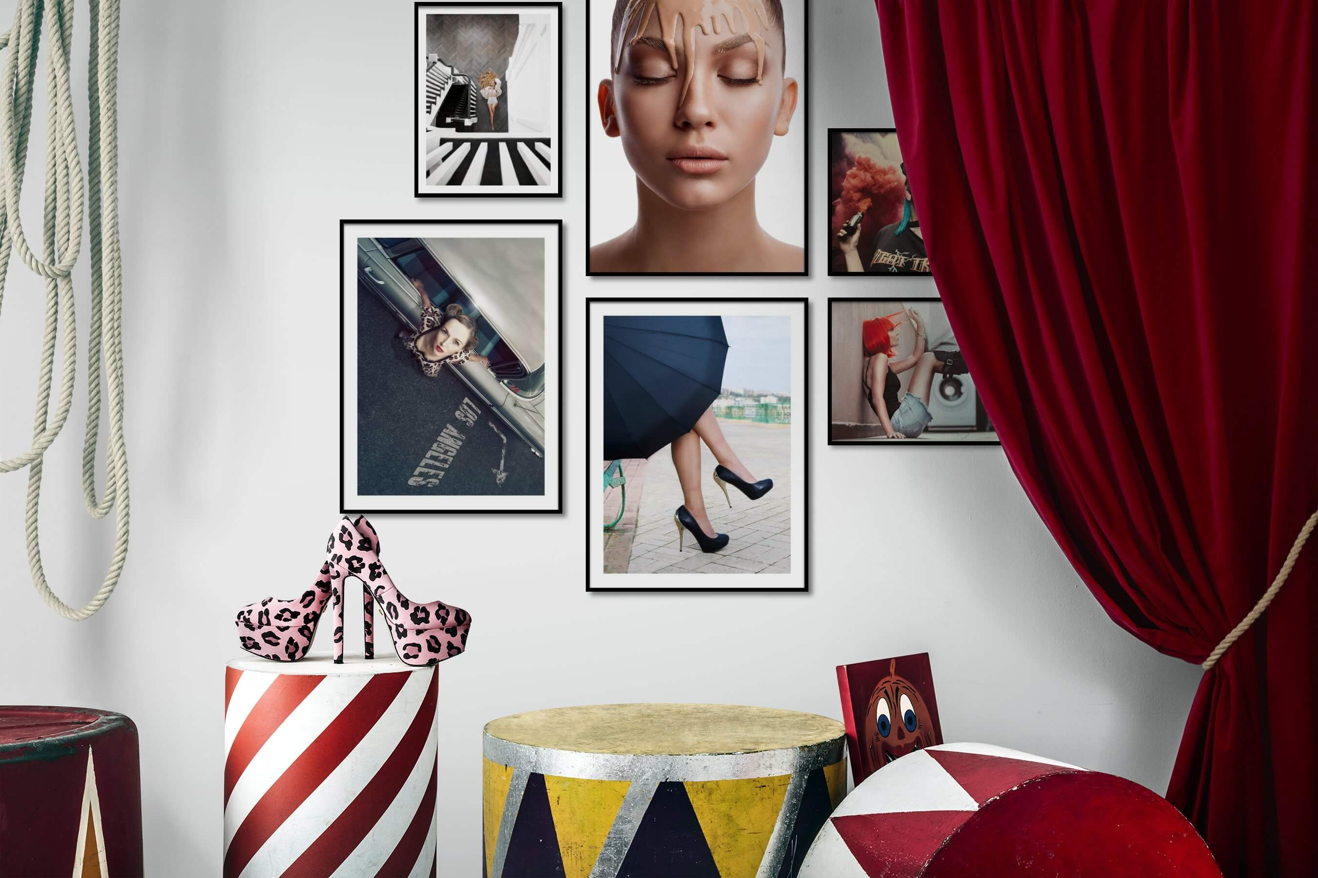 Gallery wall idea with six framed pictures arranged on a wall depicting Fashion & Beauty, Americana, Vintage, and City Life