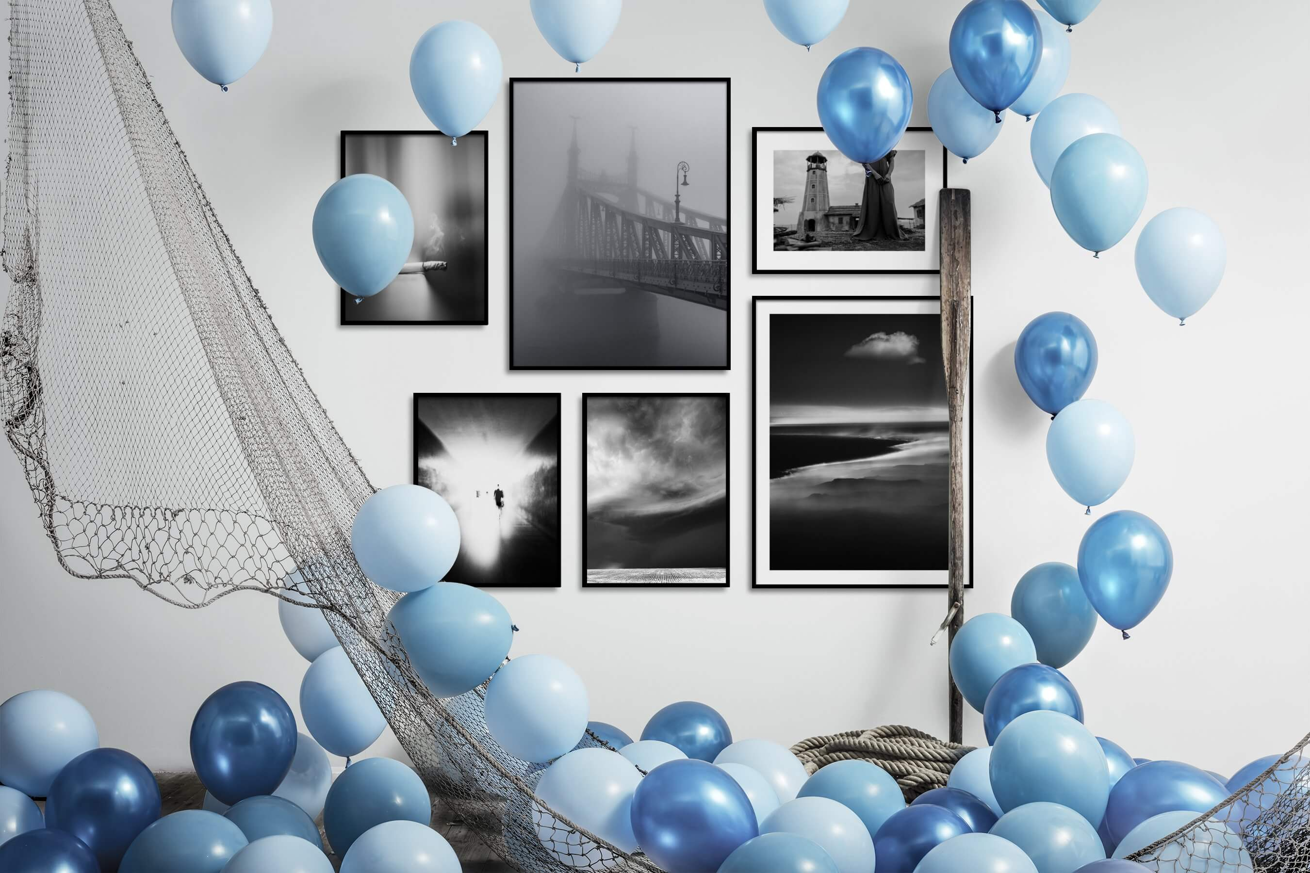 Gallery wall idea with six framed pictures arranged on a wall depicting Black & White, For the Moderate, City Life, Country Life, Artsy, Vintage, and Nature