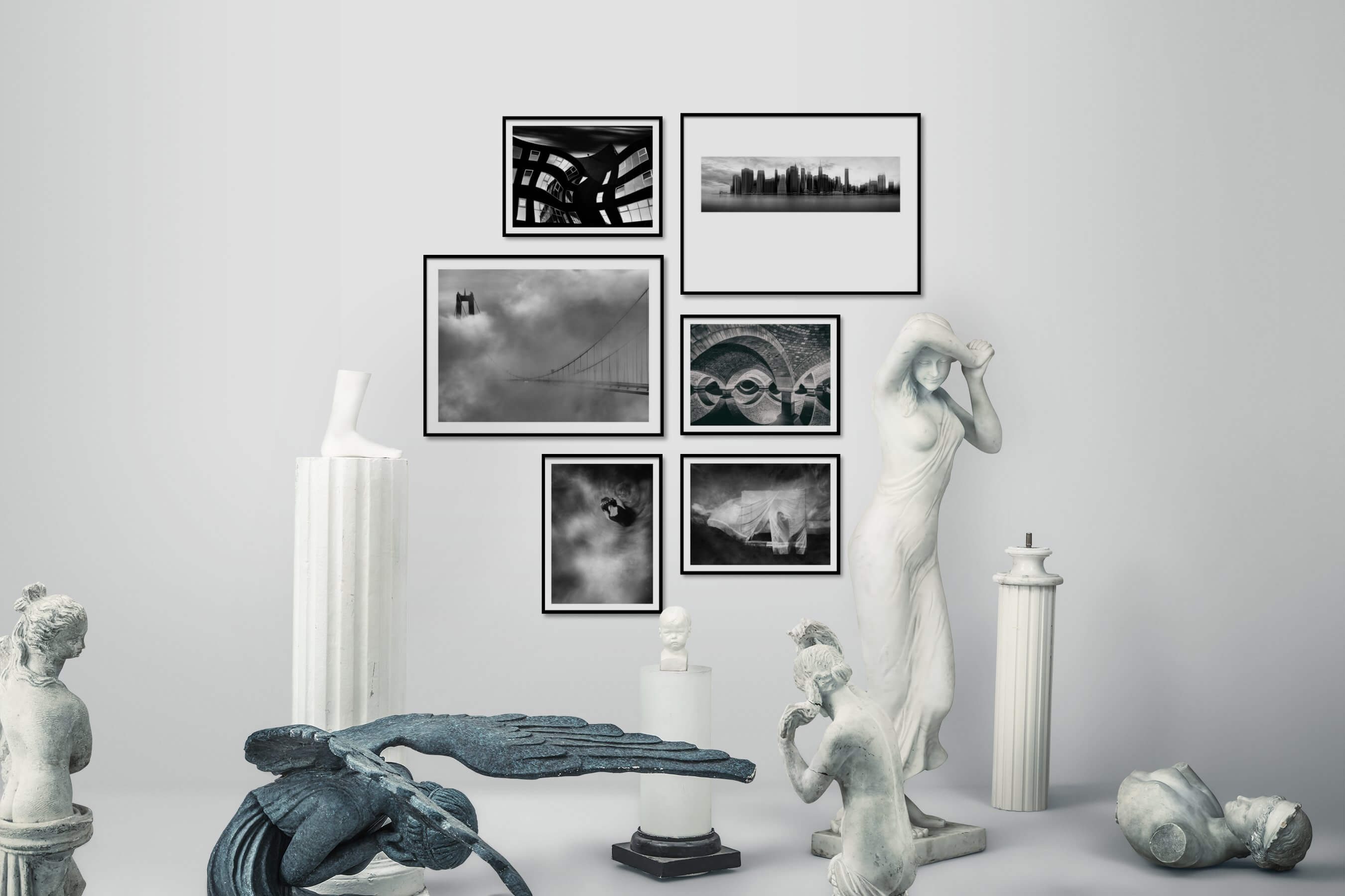Gallery wall idea with six framed pictures arranged on a wall depicting Black & White, For the Moderate, City Life, Americana, For the Maximalist, and Artsy
