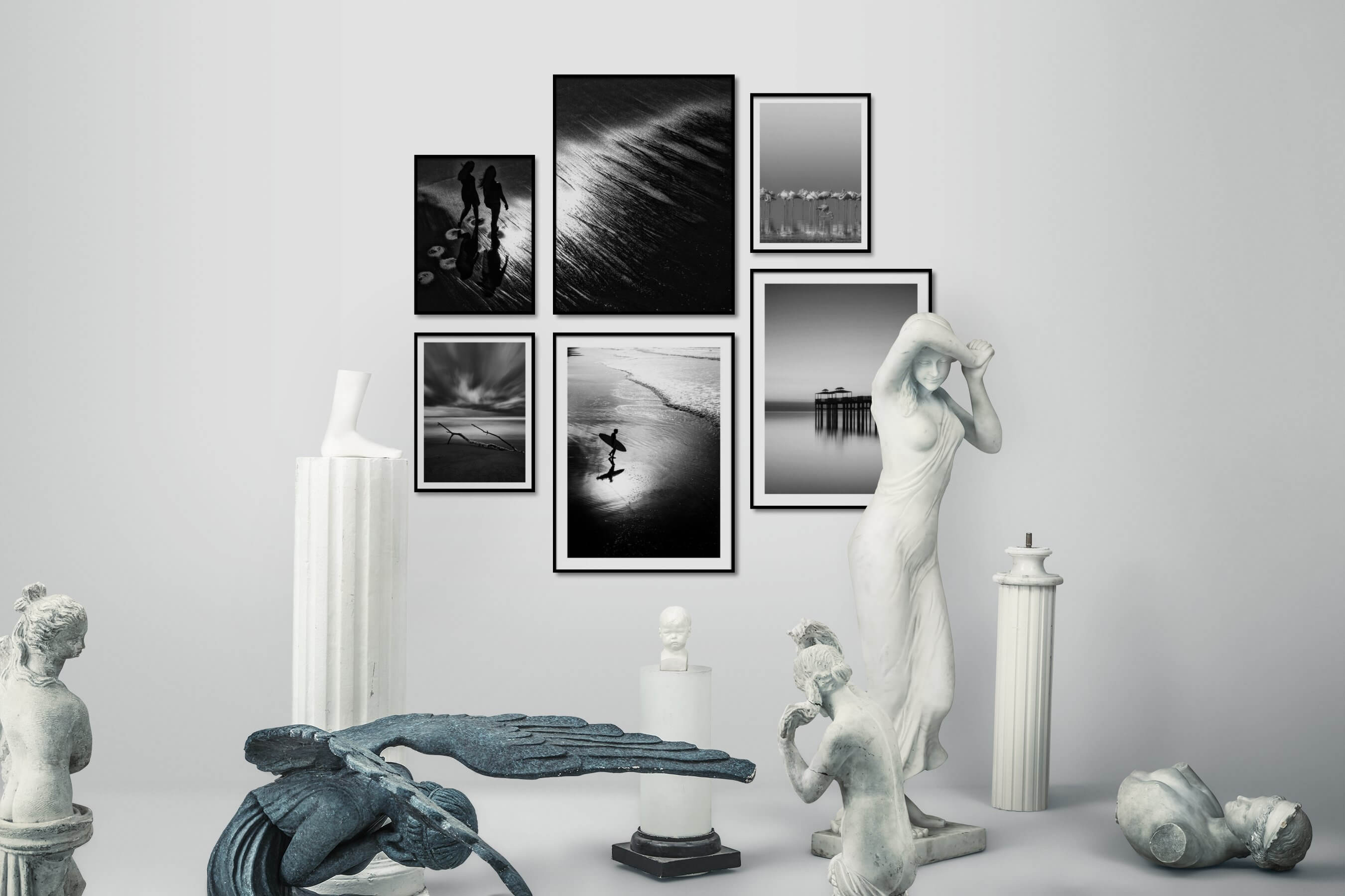 Gallery wall idea with six framed pictures arranged on a wall depicting Black & White, For the Moderate, Beach & Water, Dark Tones, For the Minimalist, Animals, and Mindfulness