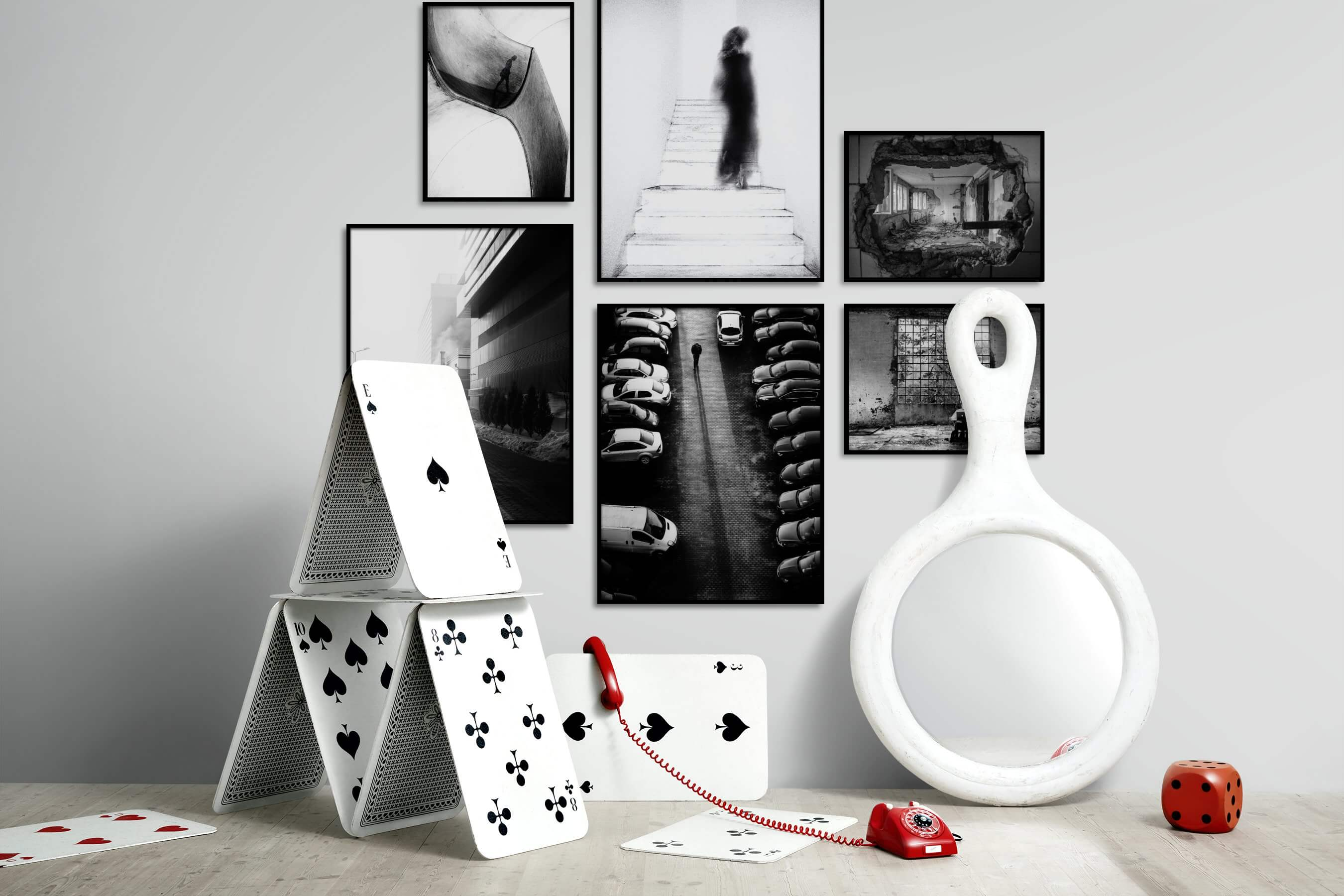 Gallery wall idea with six framed pictures arranged on a wall depicting Artsy, Black & White, For the Moderate, City Life, and Vintage