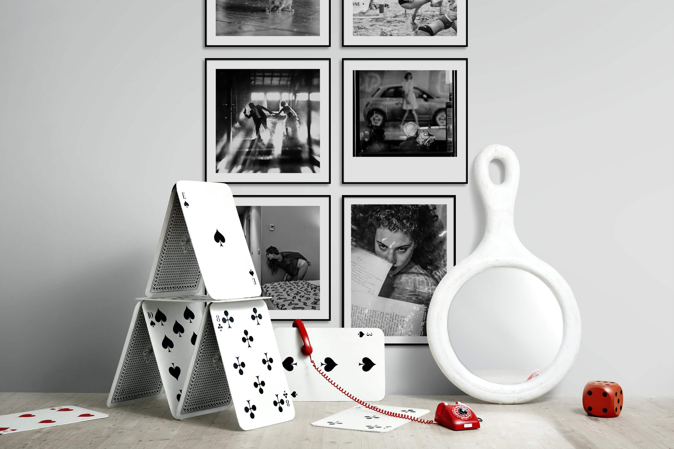 Gallery wall idea with six framed pictures arranged on a wall depicting Black & White, Animals, Beach & Water, Artsy, and City Life