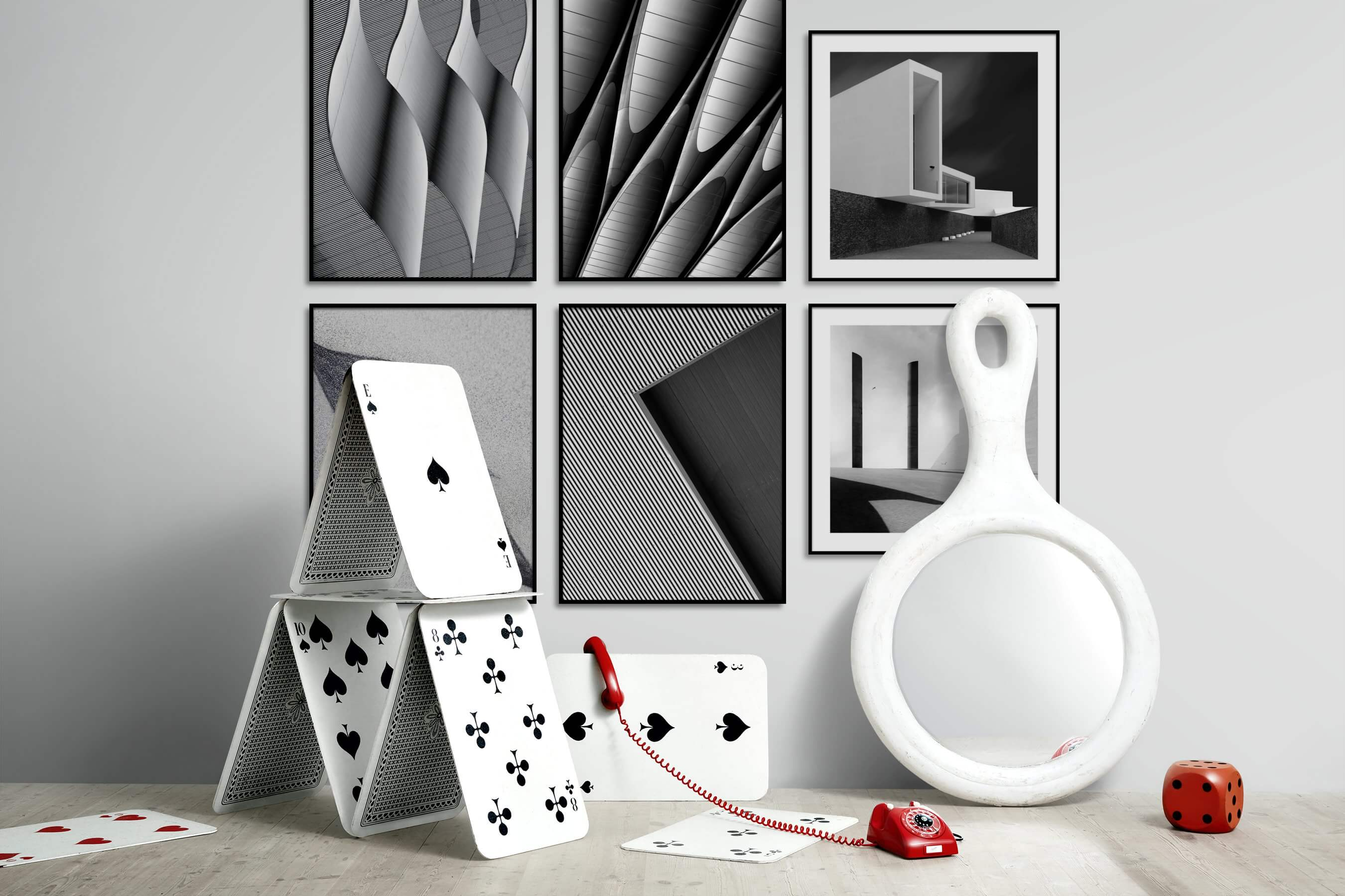 Gallery wall idea with six framed pictures arranged on a wall depicting Black & White, For the Maximalist, and For the Minimalist