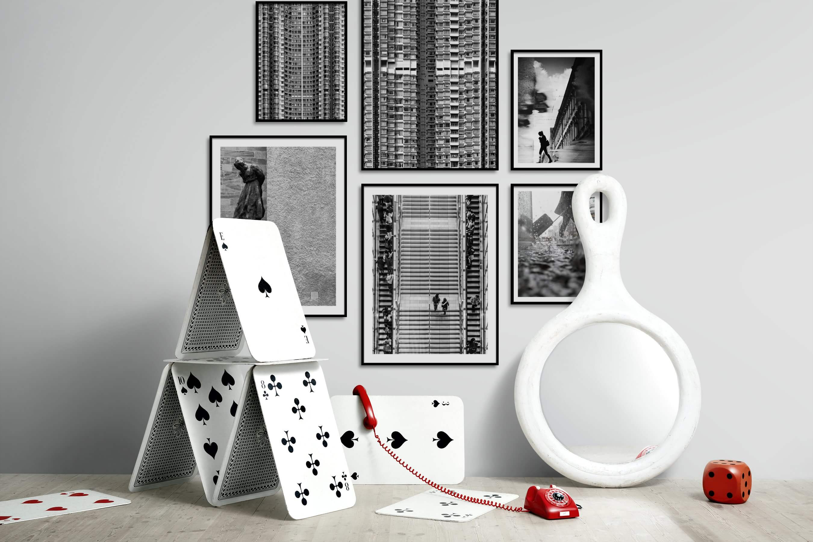 Gallery wall idea with six framed pictures arranged on a wall depicting Black & White, For the Maximalist, City Life, and For the Moderate