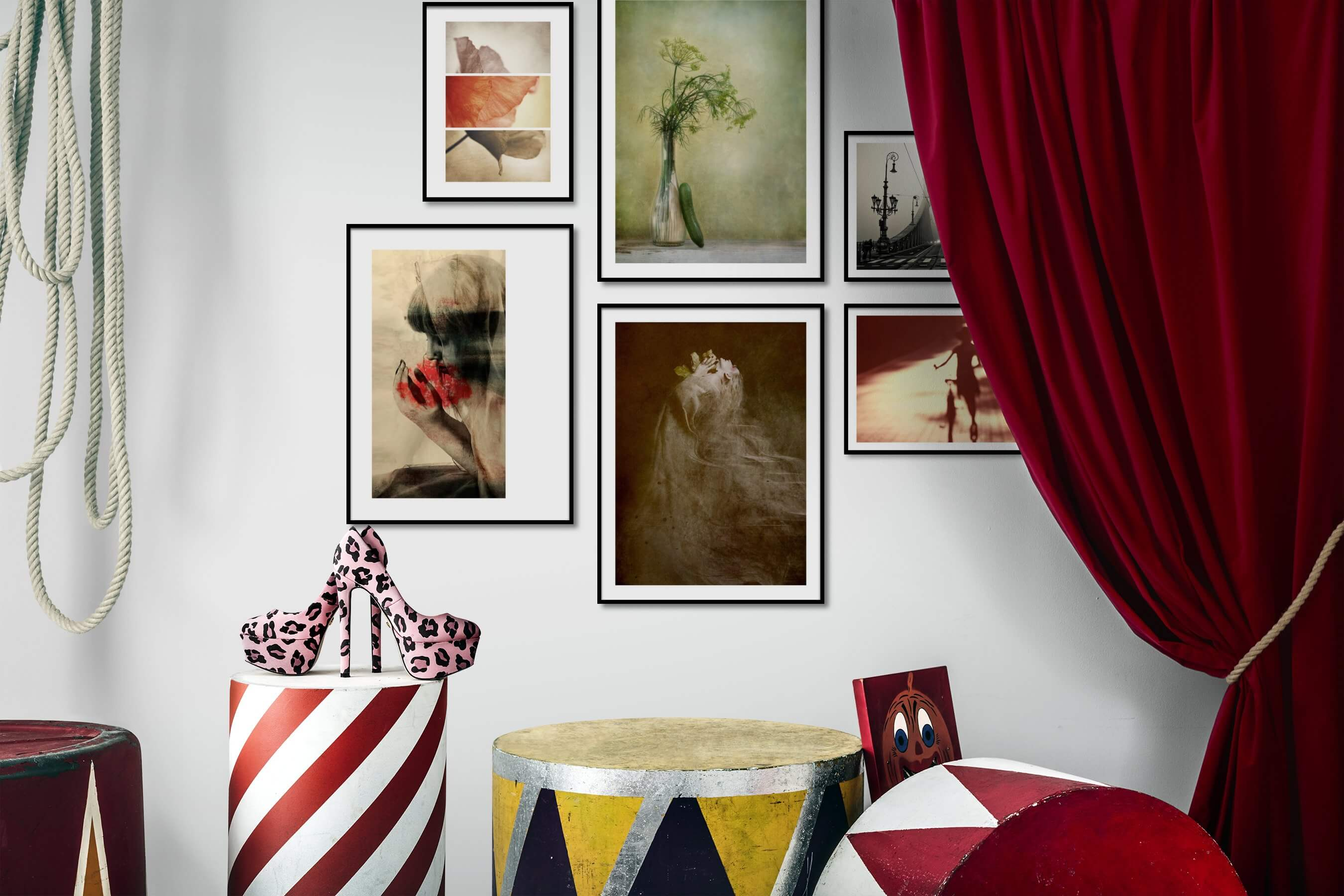 Gallery wall idea with six framed pictures arranged on a wall depicting Flowers & Plants, Vintage, Artsy, Black & White, City Life, Fashion & Beauty, and For the Moderate