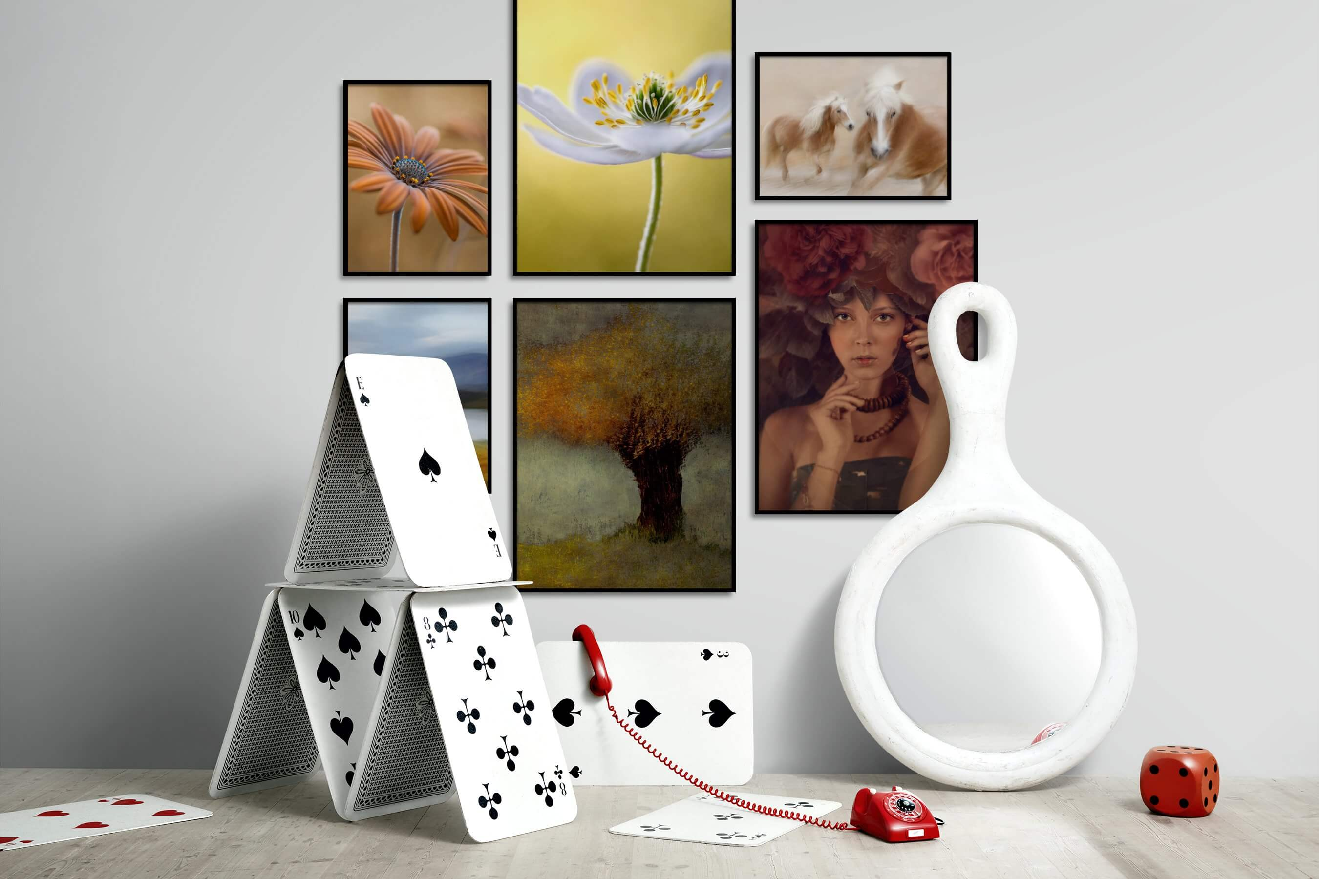 Gallery wall idea with six framed pictures arranged on a wall depicting Flowers & Plants, For the Minimalist, Nature, Animals, Country Life, and Fashion & Beauty