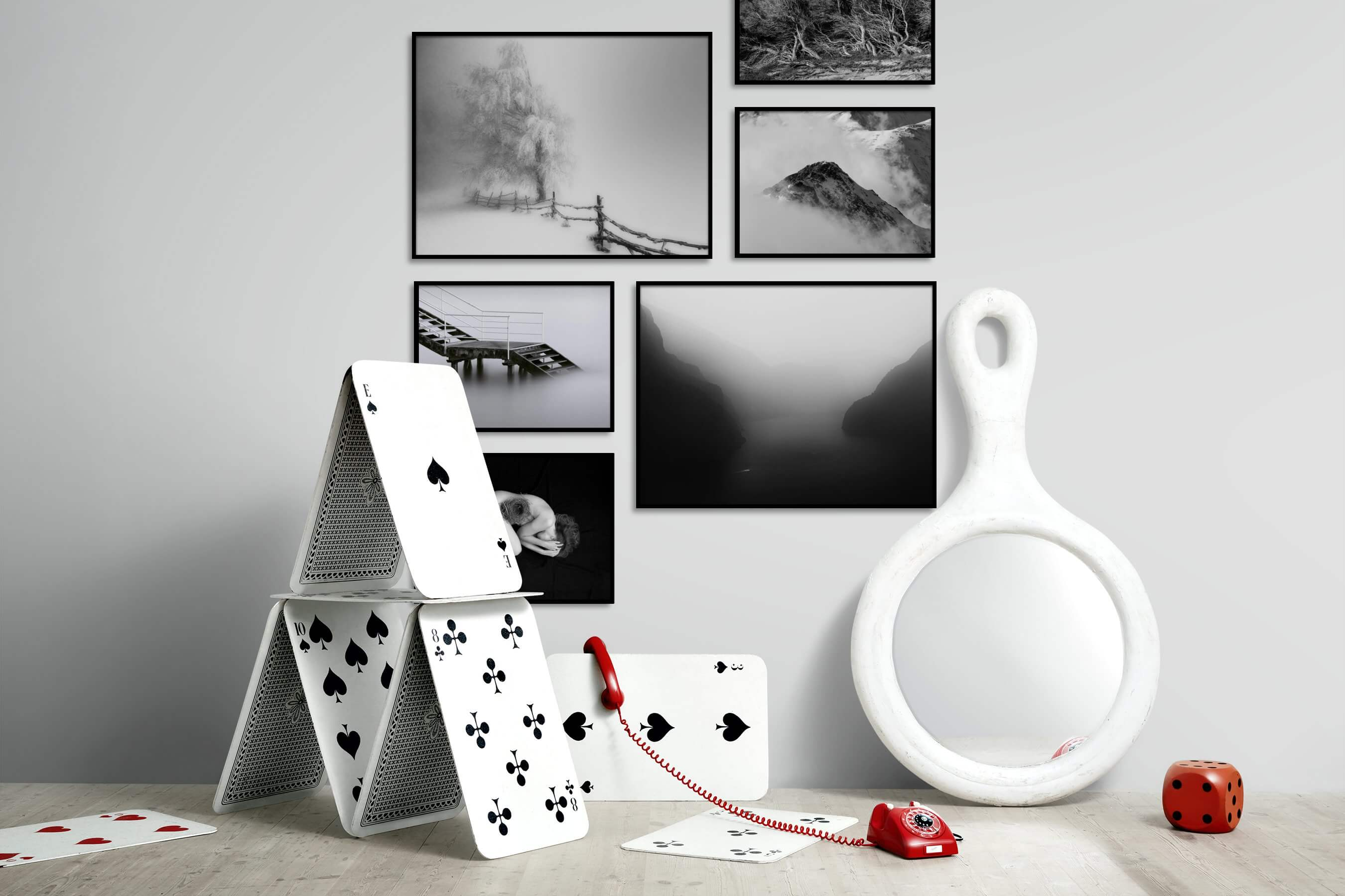Gallery wall idea with six framed pictures arranged on a wall depicting Black & White, For the Minimalist, Country Life, Nature, Mindfulness, Artsy, Dark Tones, and For the Moderate