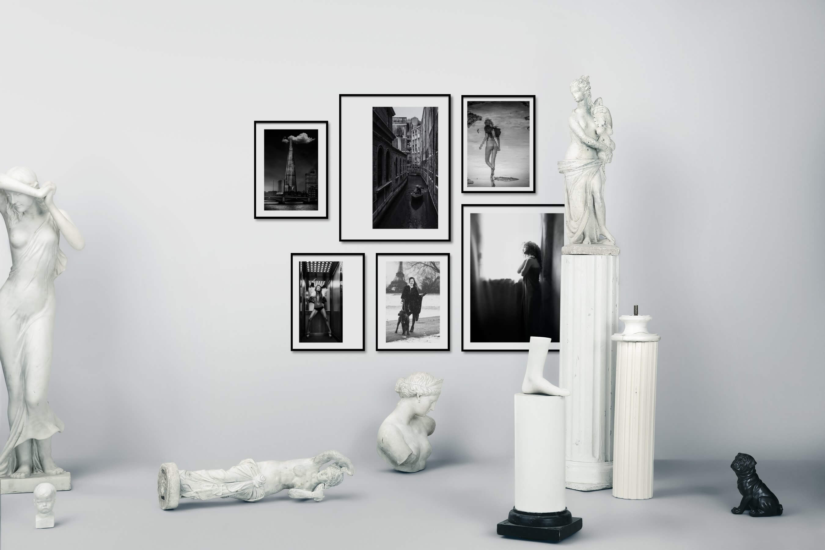 Gallery wall idea with six framed pictures arranged on a wall depicting Black & White, For the Moderate, City Life, Fashion & Beauty, Bold, Animals, and For the Minimalist
