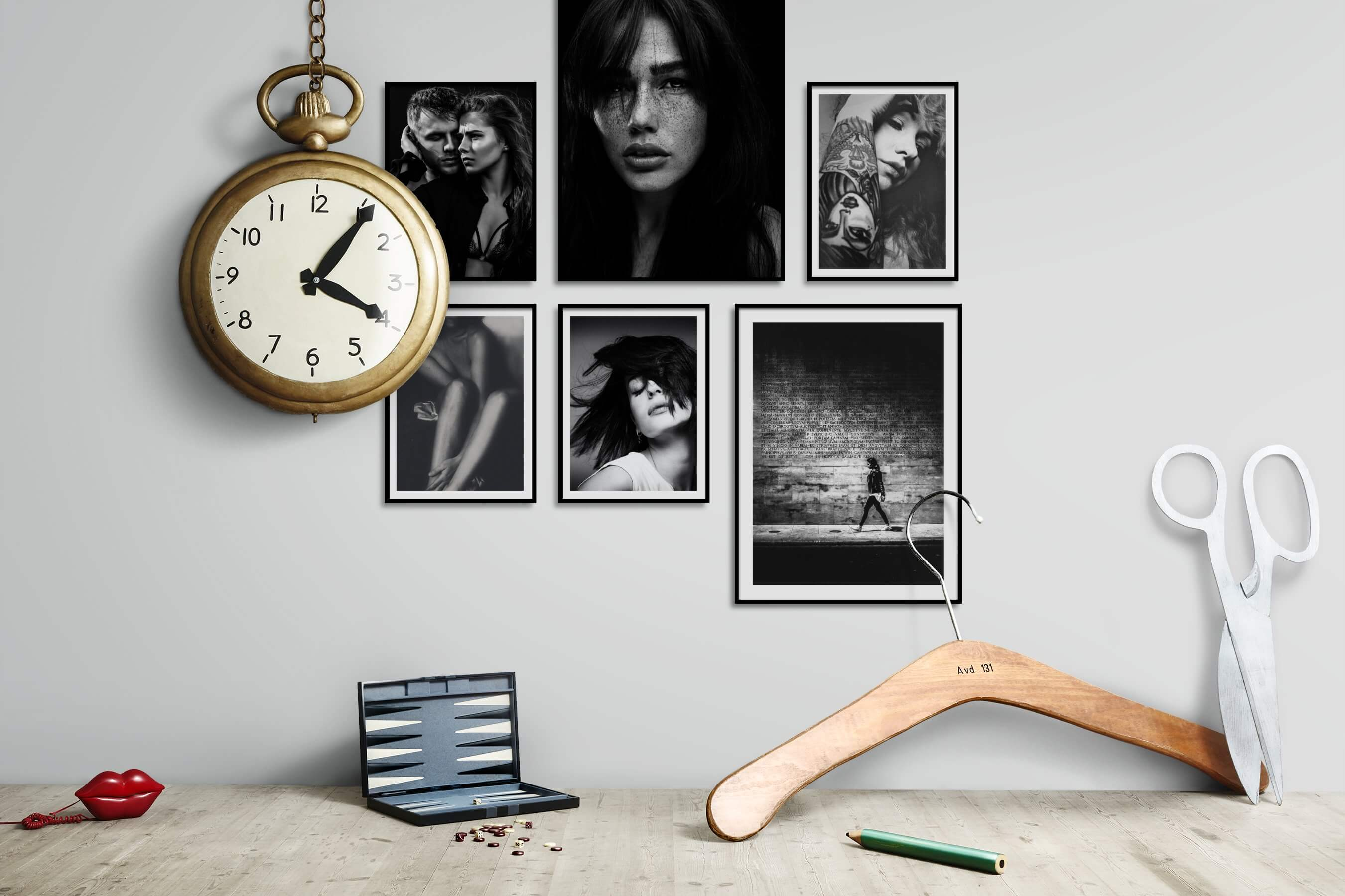 Gallery wall idea with six framed pictures arranged on a wall depicting Fashion & Beauty, Black & White, Dark Tones, and City Life