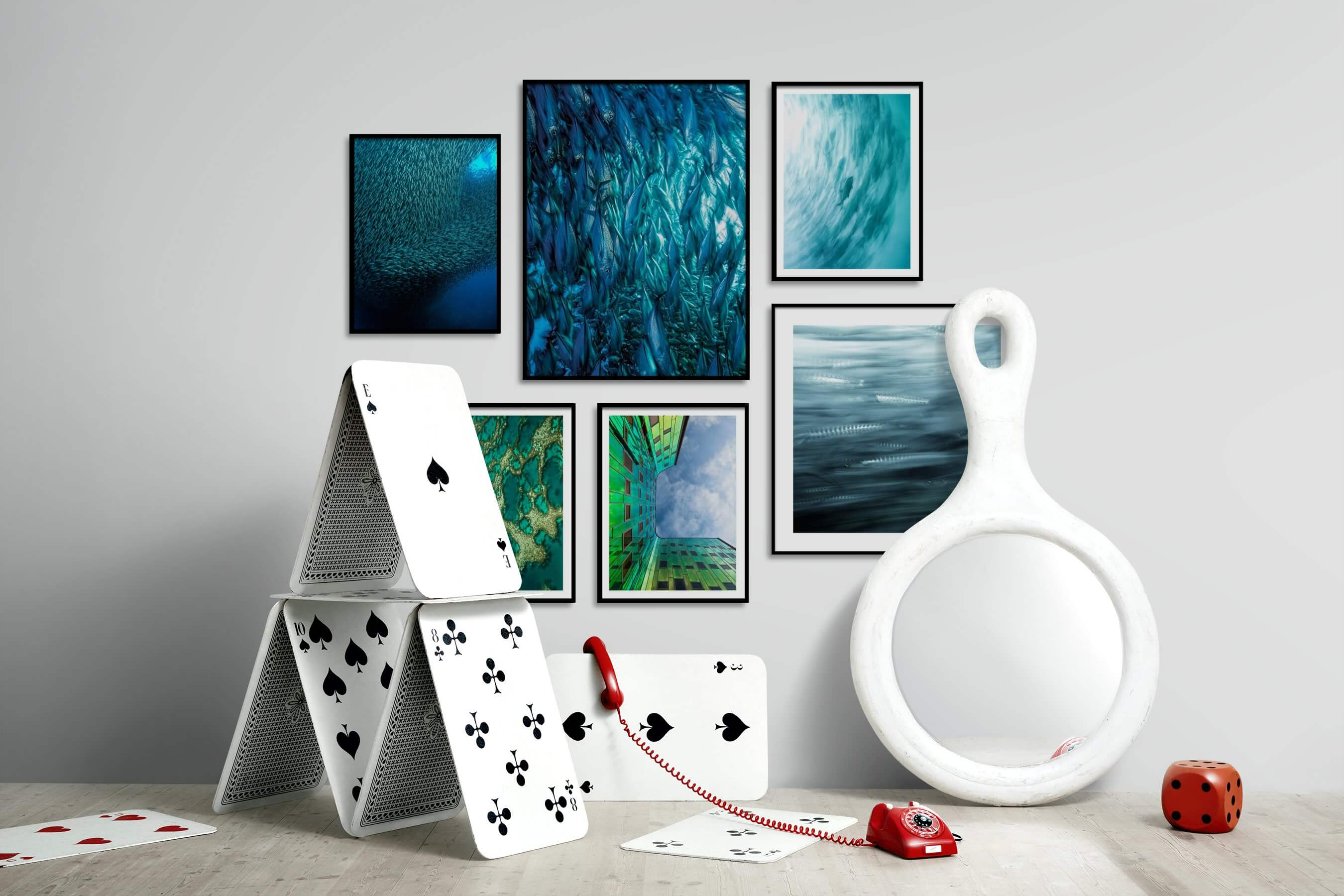 Gallery wall idea with six framed pictures arranged on a wall depicting Animals, Beach & Water, For the Maximalist, For the Moderate, and Nature