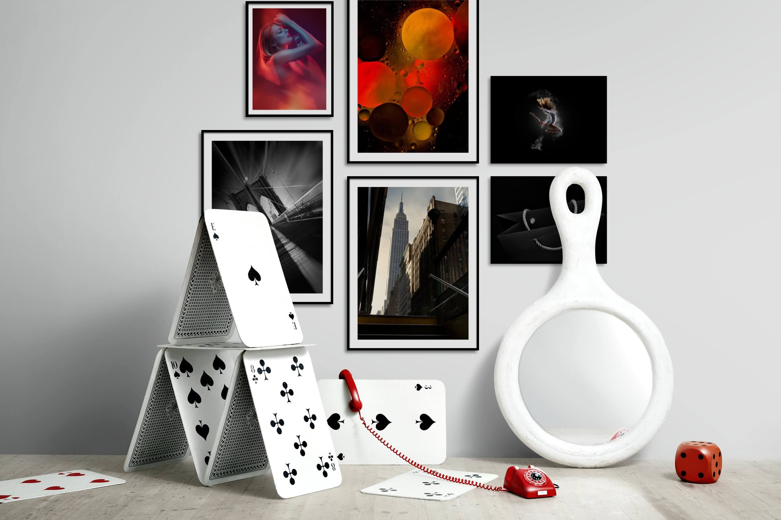 Gallery wall idea with six framed pictures arranged on a wall depicting Fashion & Beauty, For the Moderate, Black & White, City Life, Americana, Dark Tones, and For the Minimalist