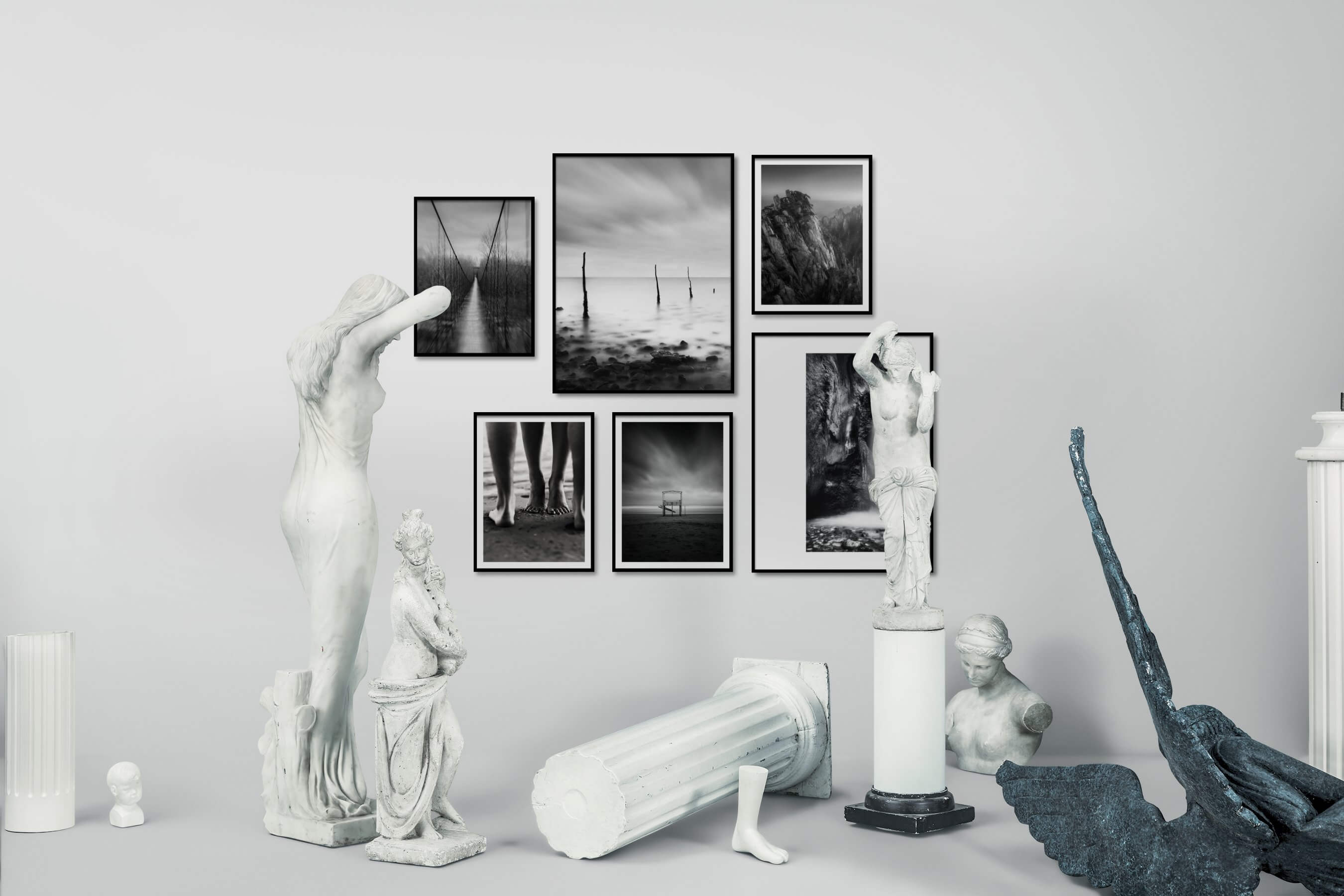 Gallery wall idea with six framed pictures arranged on a wall depicting Black & White, Nature, Beach & Water, Mindfulness, For the Moderate, and For the Minimalist