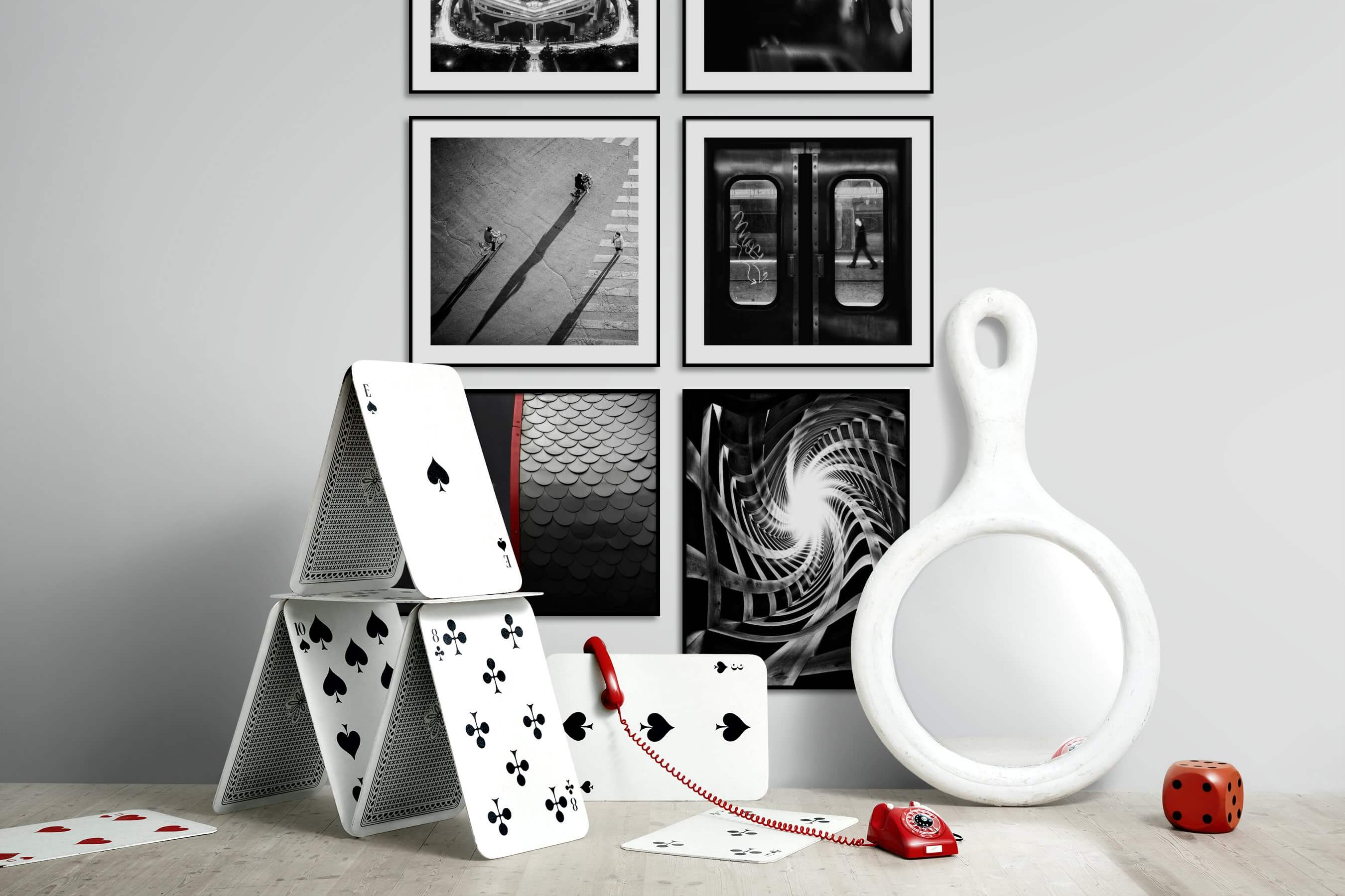 Gallery wall idea with six framed pictures arranged on a wall depicting Black & White, For the Maximalist, City Life, Vintage, For the Minimalist, and For the Moderate