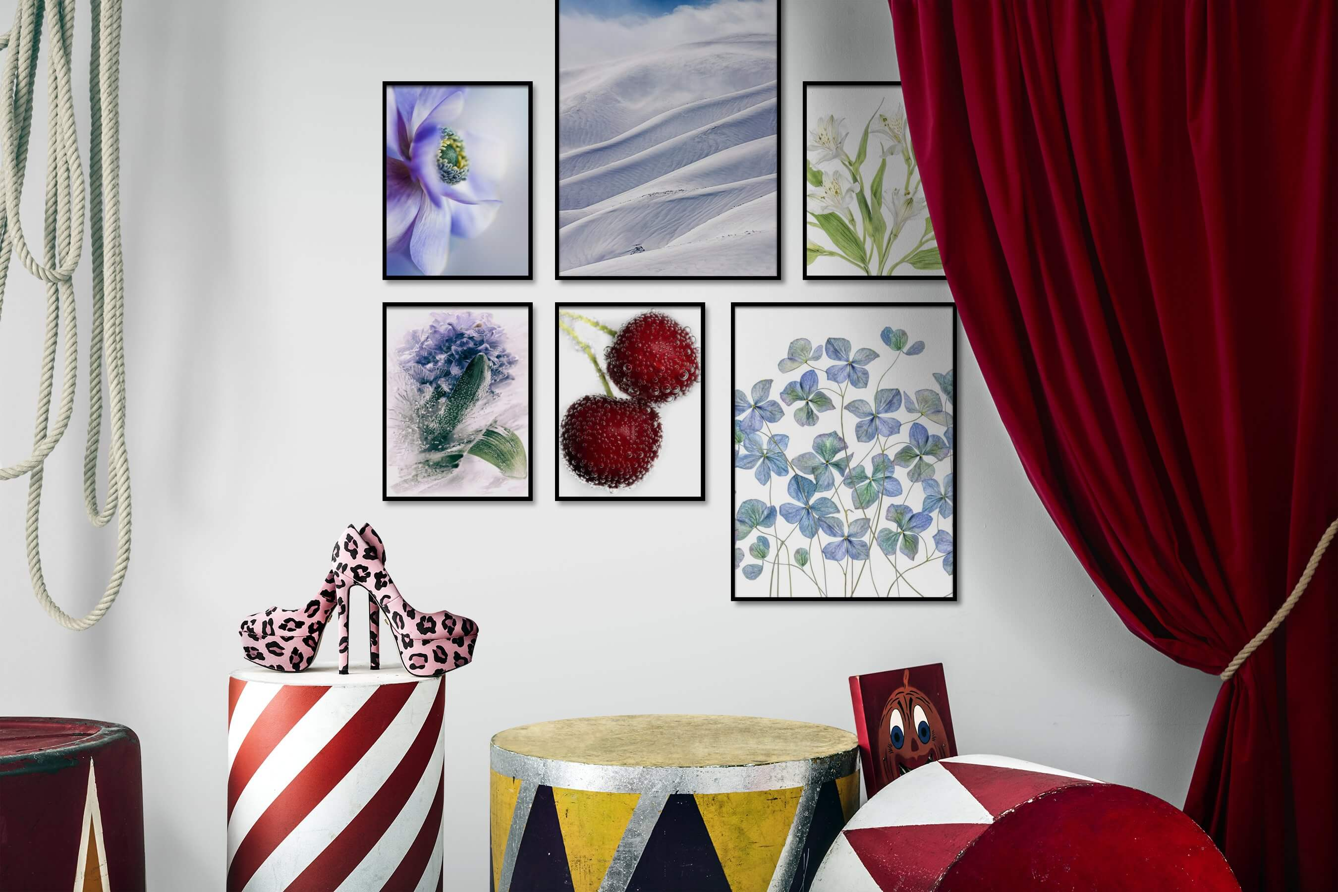 Gallery wall idea with six framed pictures arranged on a wall depicting Flowers & Plants, For the Moderate, Nature, Bright Tones, and For the Minimalist