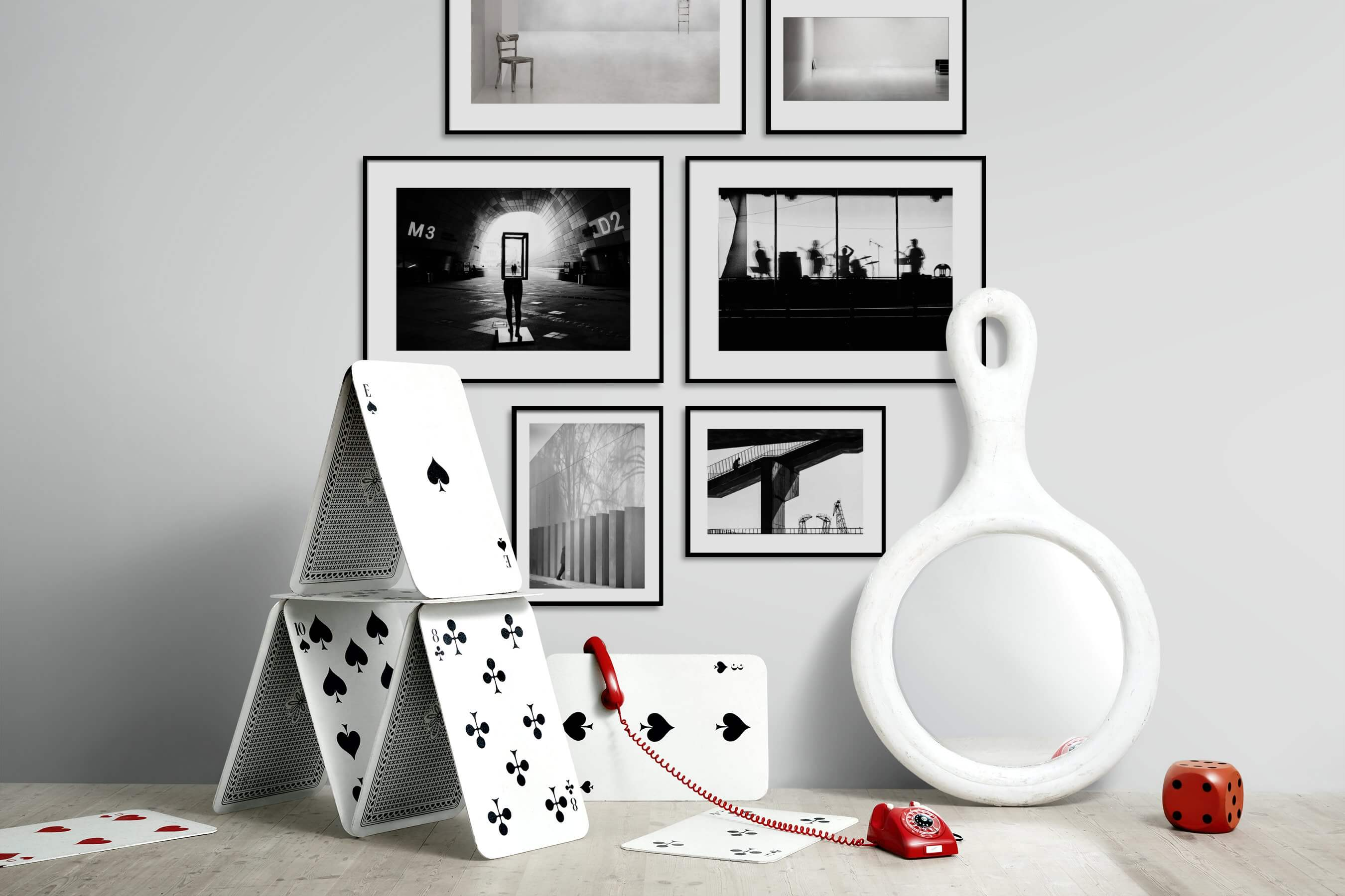 Gallery wall idea with six framed pictures arranged on a wall depicting For the Minimalist, Black & White, Artsy, City Life, and For the Moderate