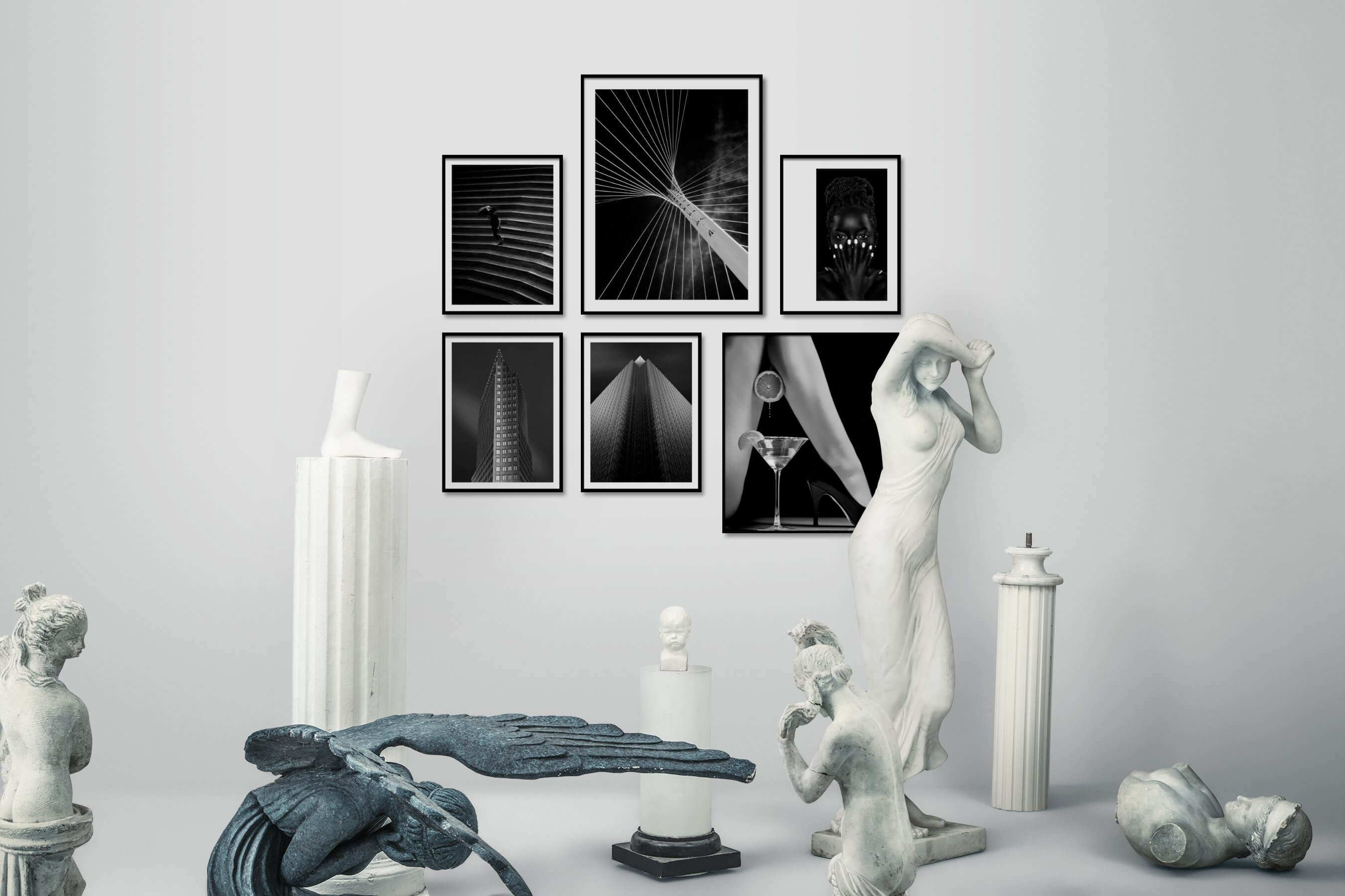 Gallery wall idea with six framed pictures arranged on a wall depicting Black & White, For the Moderate, For the Minimalist, City Life, and Fashion & Beauty