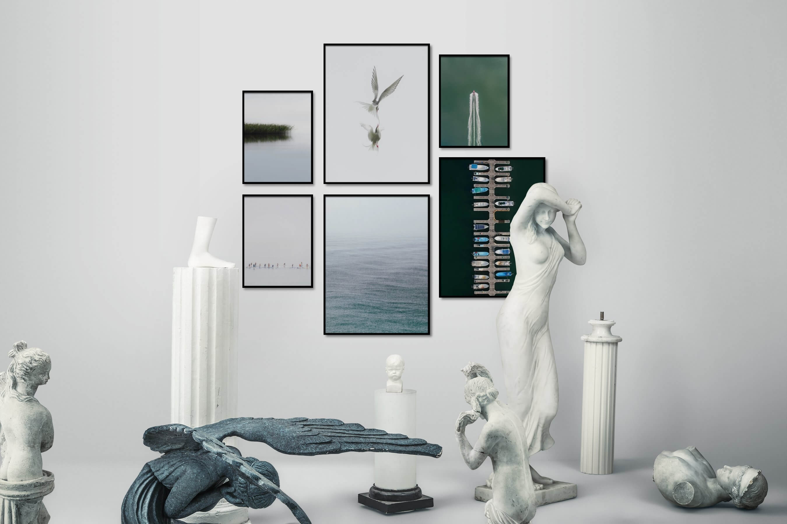 Gallery wall idea with six framed pictures arranged on a wall depicting For the Minimalist, Nature, Beach & Water, Mindfulness, Bright Tones, Animals, and For the Moderate