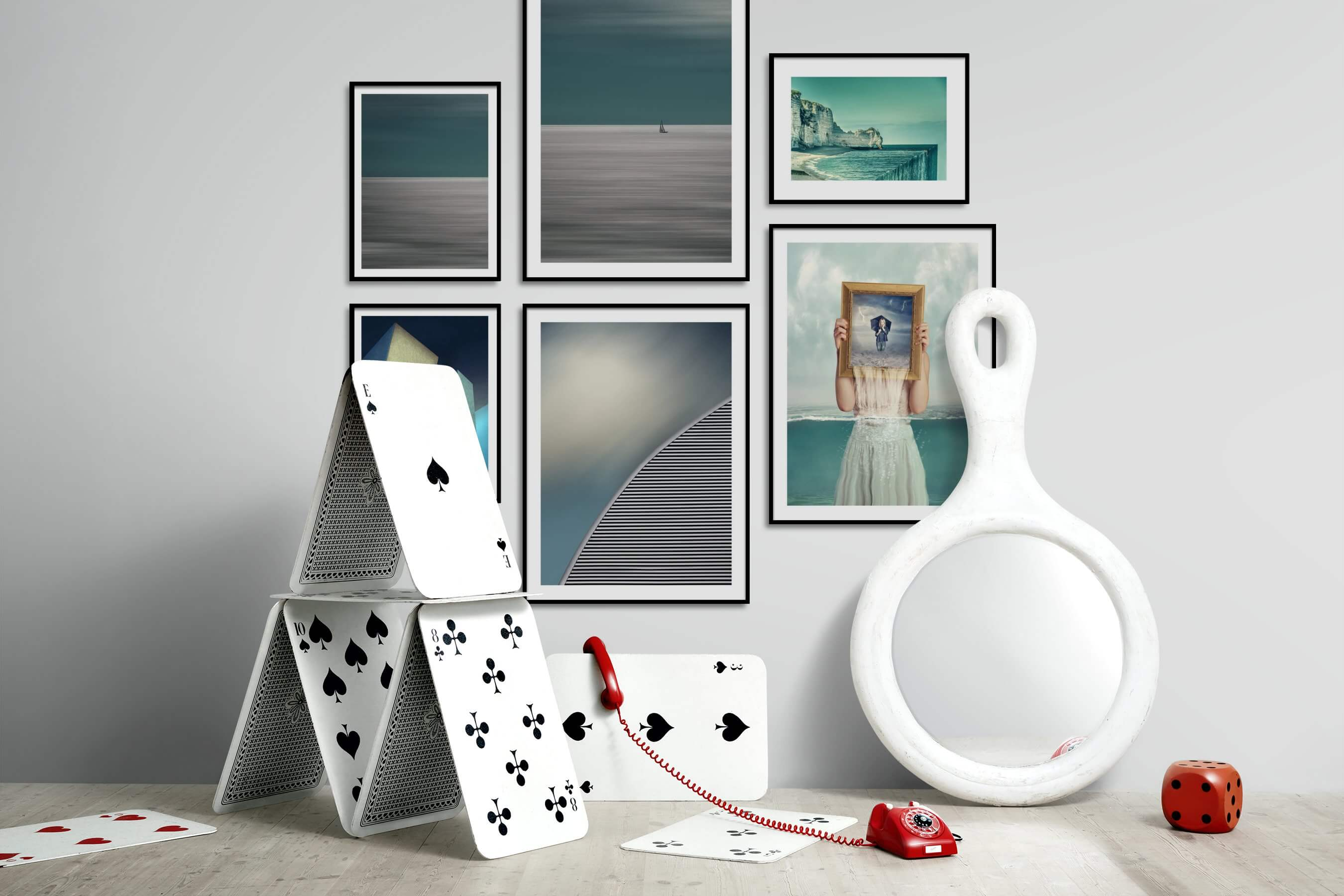 Gallery wall idea with six framed pictures arranged on a wall depicting For the Minimalist, Beach & Water, and Artsy