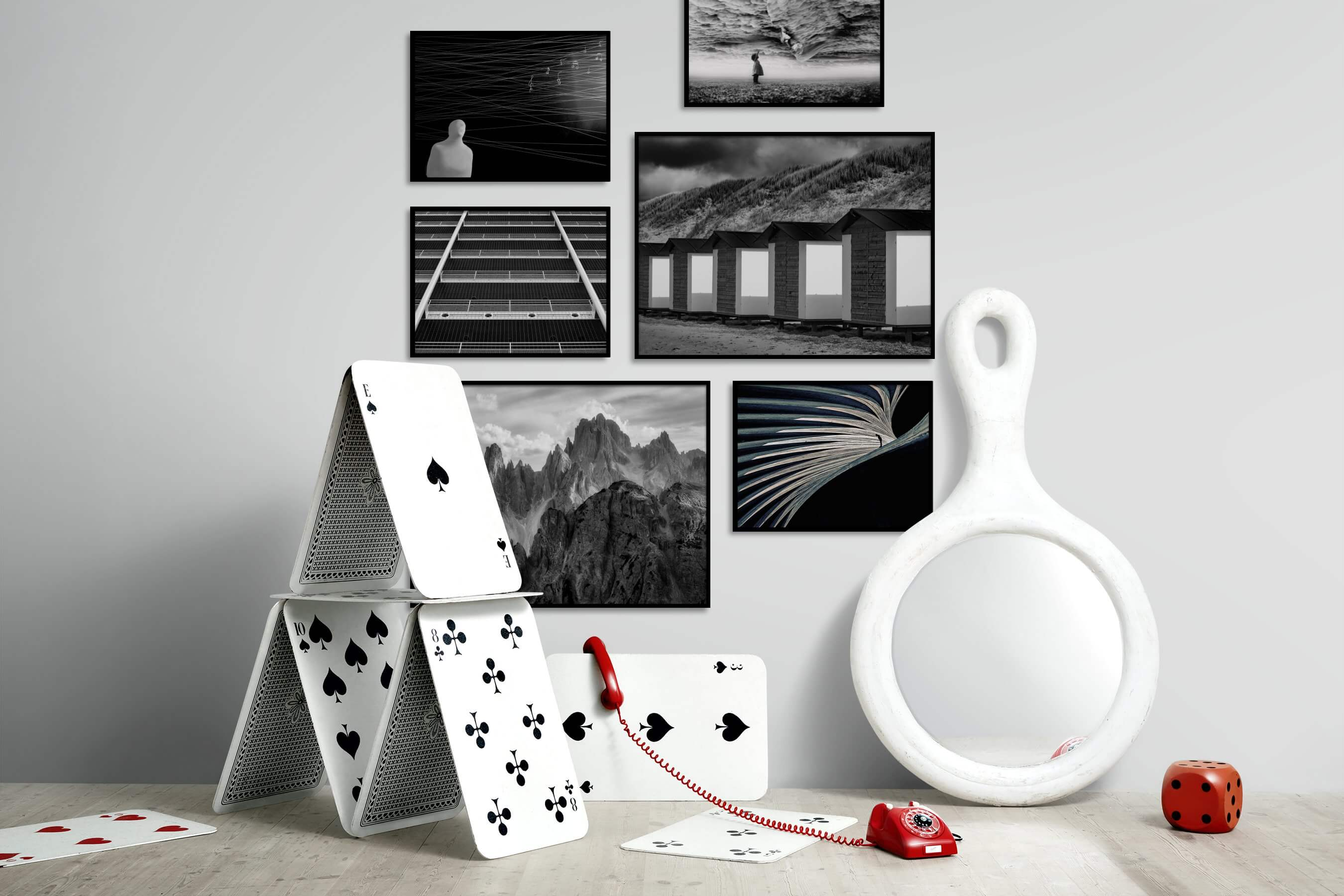 Gallery wall idea with six framed pictures arranged on a wall depicting Artsy, Black & White, For the Moderate, City Life, Beach & Water, and Nature