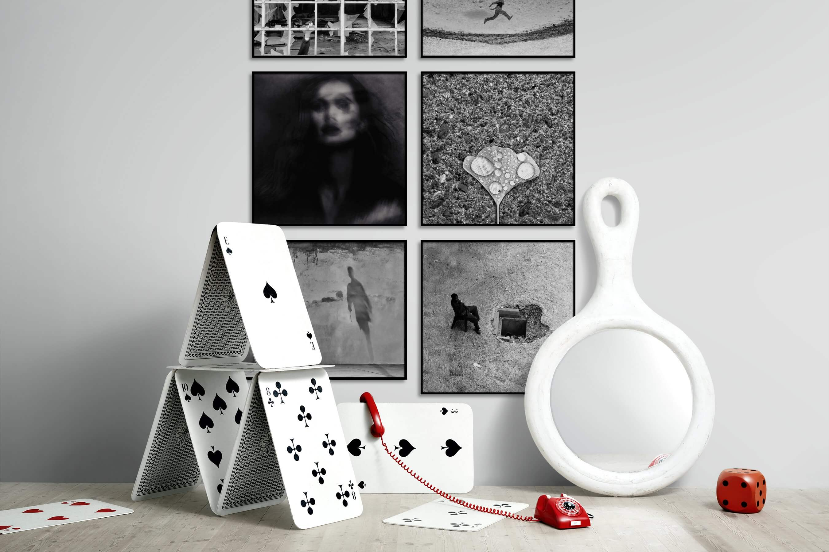 Gallery wall idea with six framed pictures arranged on a wall depicting Artsy, Black & White, For the Maximalist, City Life, For the Minimalist, and Flowers & Plants