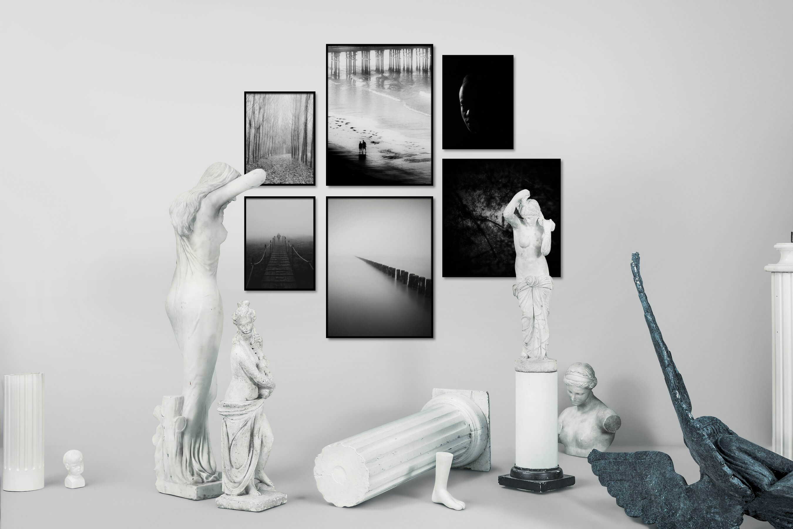 Gallery wall idea with six framed pictures arranged on a wall depicting Black & White, Nature, Beach & Water, For the Moderate, Mindfulness, For the Minimalist, Fashion & Beauty, Dark Tones, and Artsy