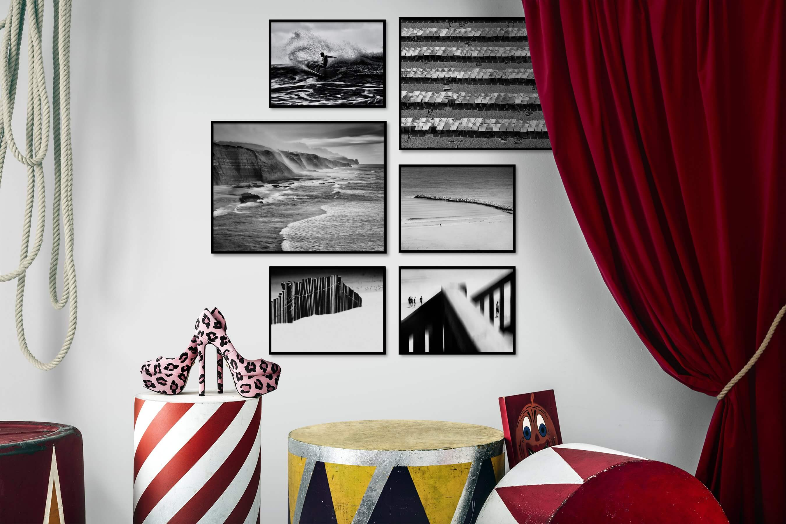 Gallery wall idea with six framed pictures arranged on a wall depicting Black & White, Beach & Water, For the Moderate, and For the Minimalist