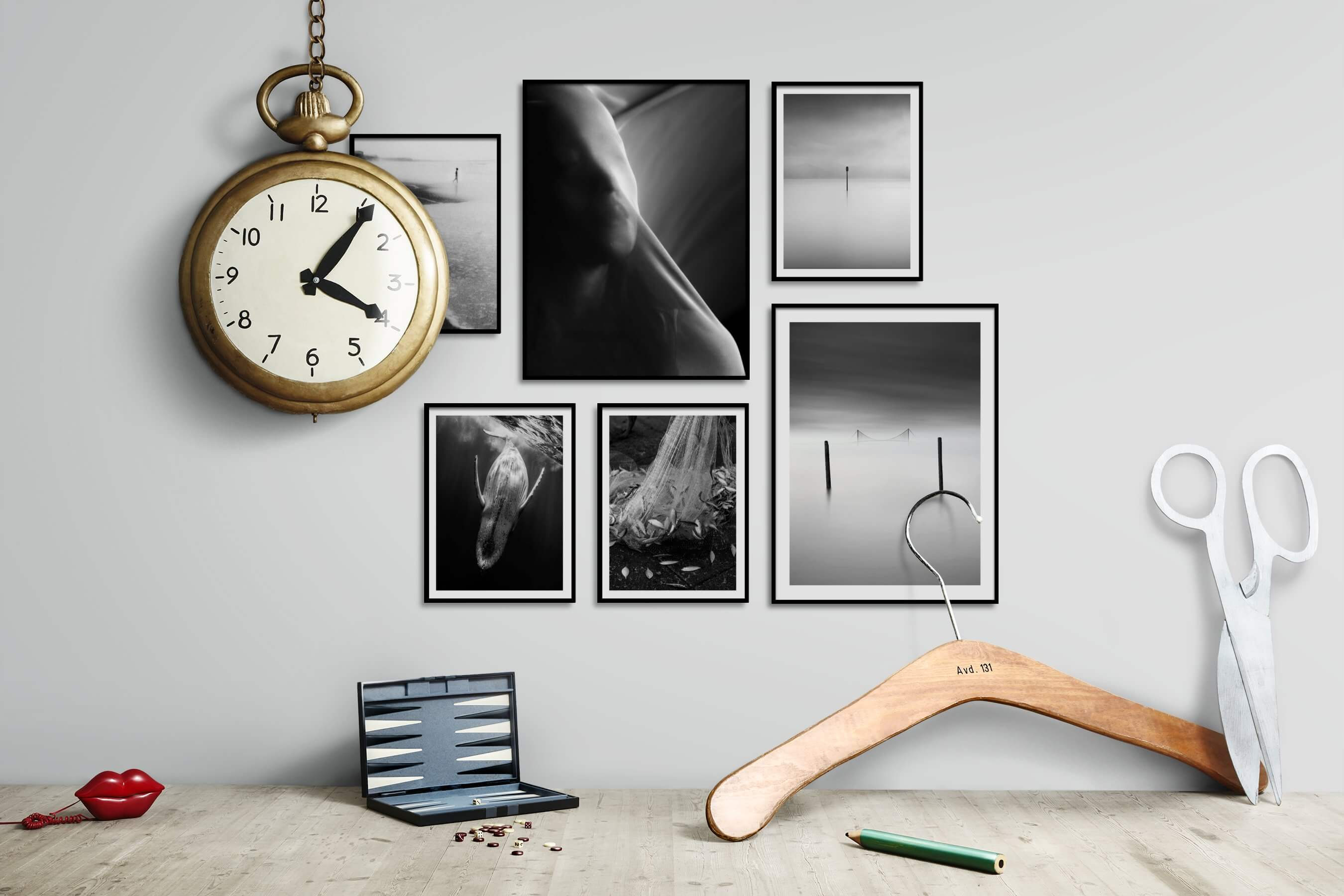 Gallery wall idea with six framed pictures arranged on a wall depicting Black & White, For the Moderate, Beach & Water, Artsy, Animals, For the Minimalist, and Mindfulness