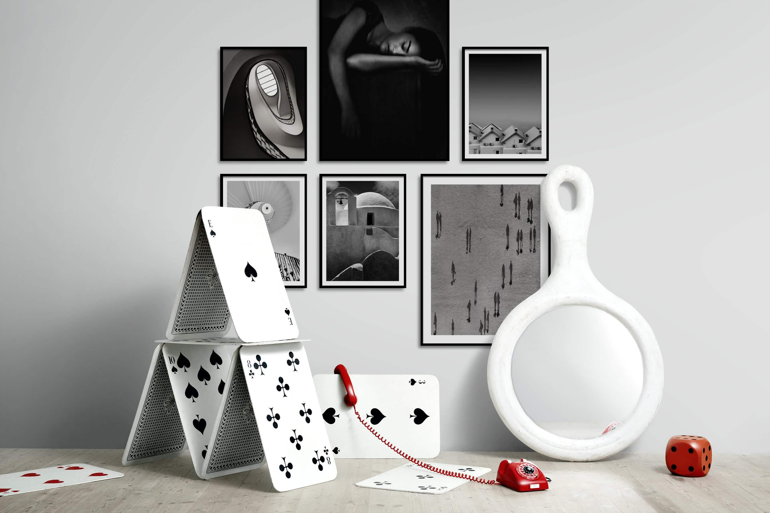 Gallery wall idea with six framed pictures arranged on a wall depicting Black & White, For the Moderate, Fashion & Beauty, Dark Tones, and For the Minimalist