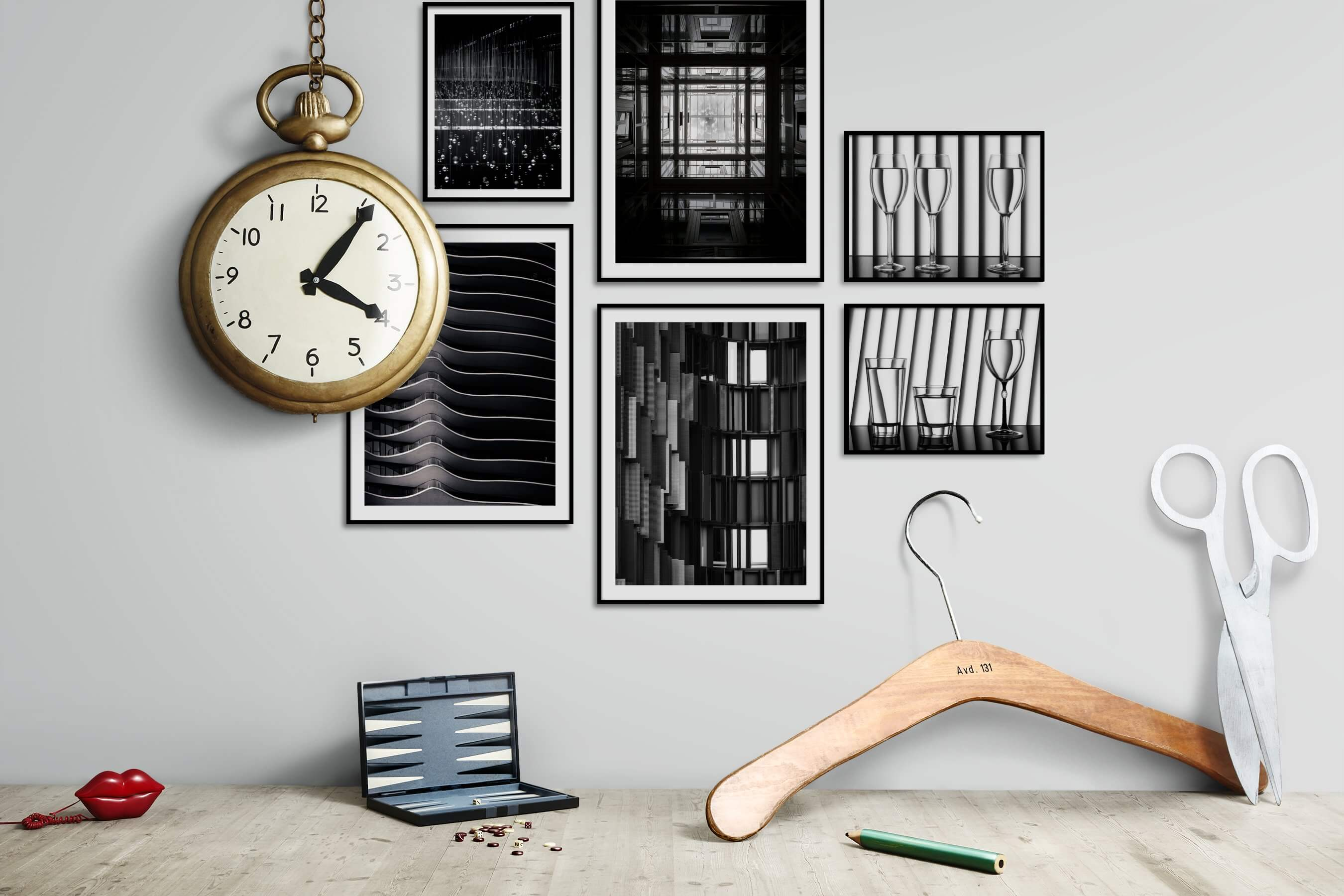 Gallery wall idea with six framed pictures arranged on a wall depicting Black & White, For the Moderate, For the Maximalist, and City Life