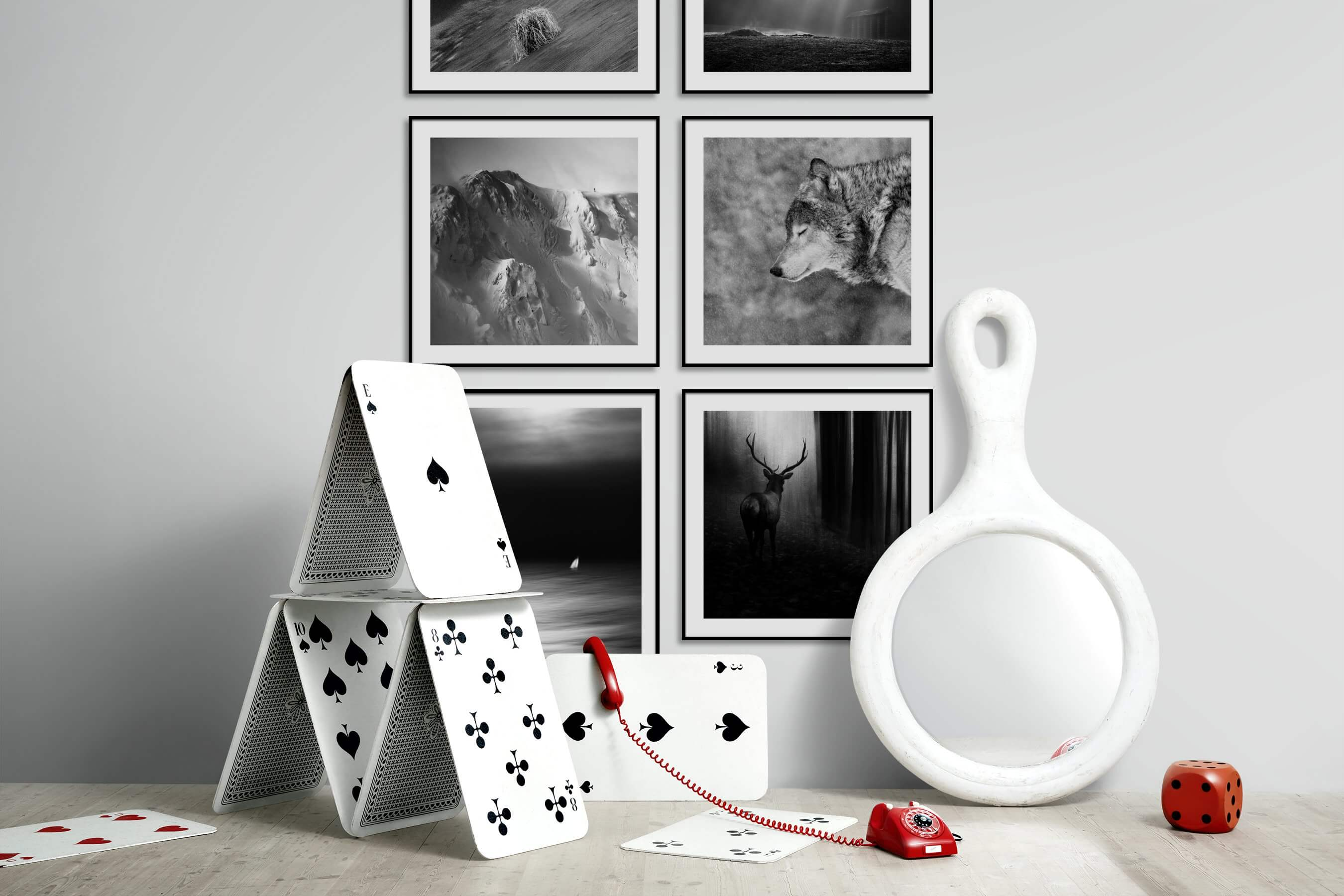 Gallery wall idea with six framed pictures arranged on a wall depicting Black & White, For the Minimalist, Nature, For the Moderate, Animals, and Beach & Water